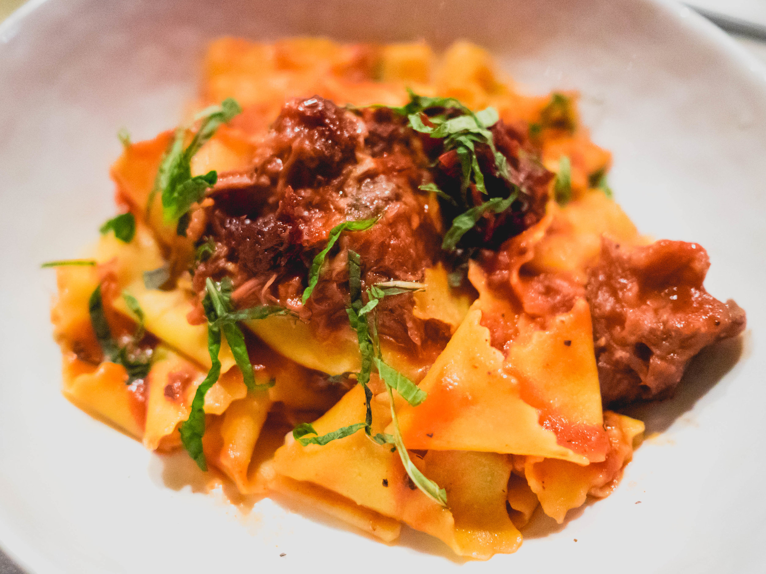 pappardelle with braised lamb, sundried tomato, mint.