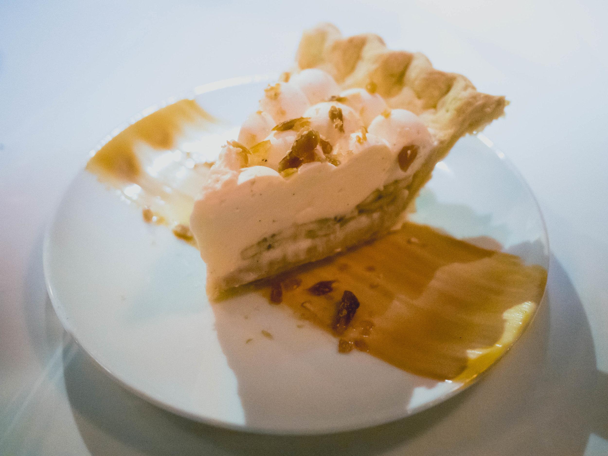 banana toffee cream pie  with toffee, fresh bananas, vanilla whipped cream.