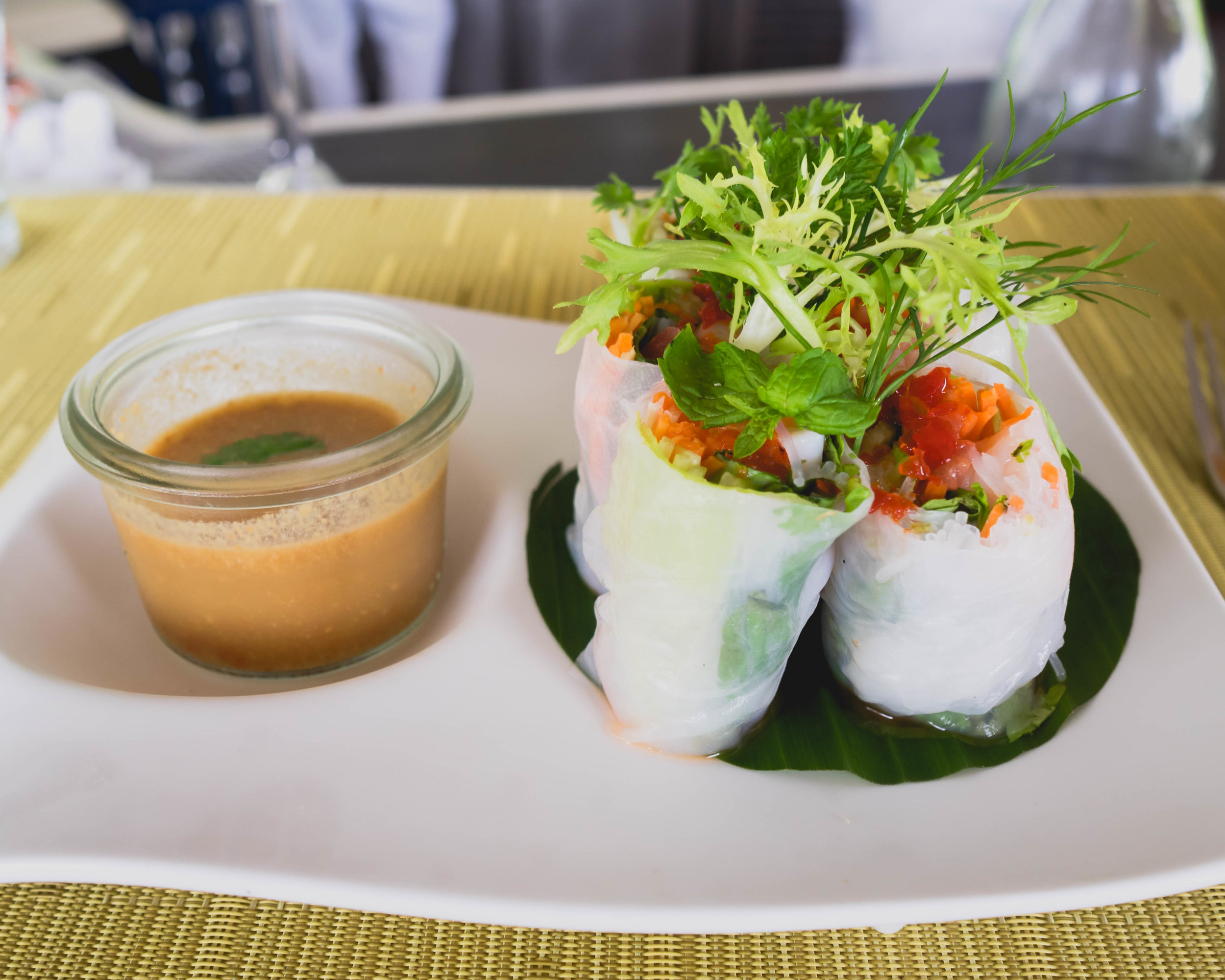 veli bar's  vietnamese prawn rice paper rolls  with indian ocean prawn, bean sprouts, lettuce, rice noodles, carrots, mint, spicy peanut dip.