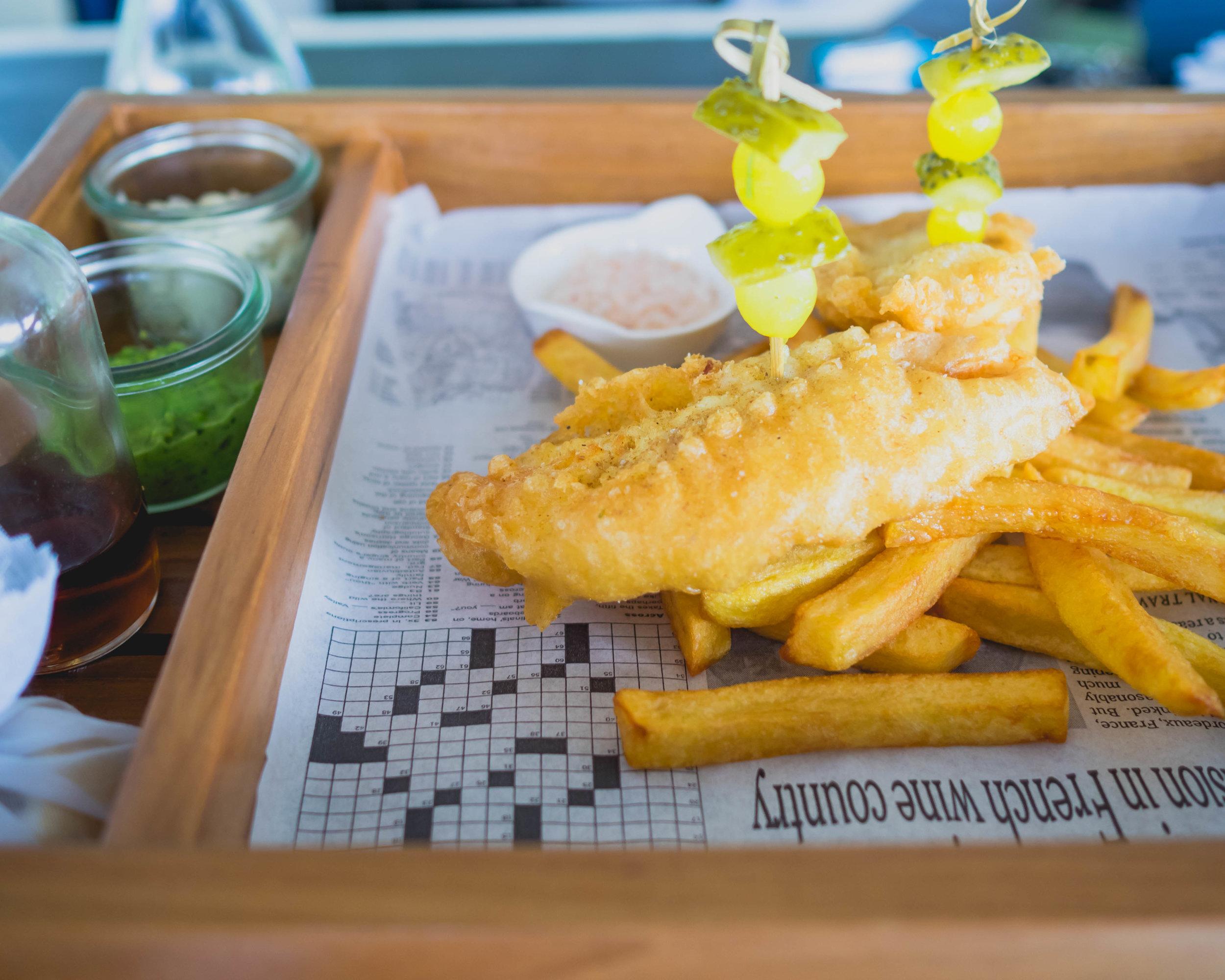 fish and chips  at veli bar: beer battered snapper, homemade chips, mush peas, pickles, lemon, tartar sauce, malt vinegar.