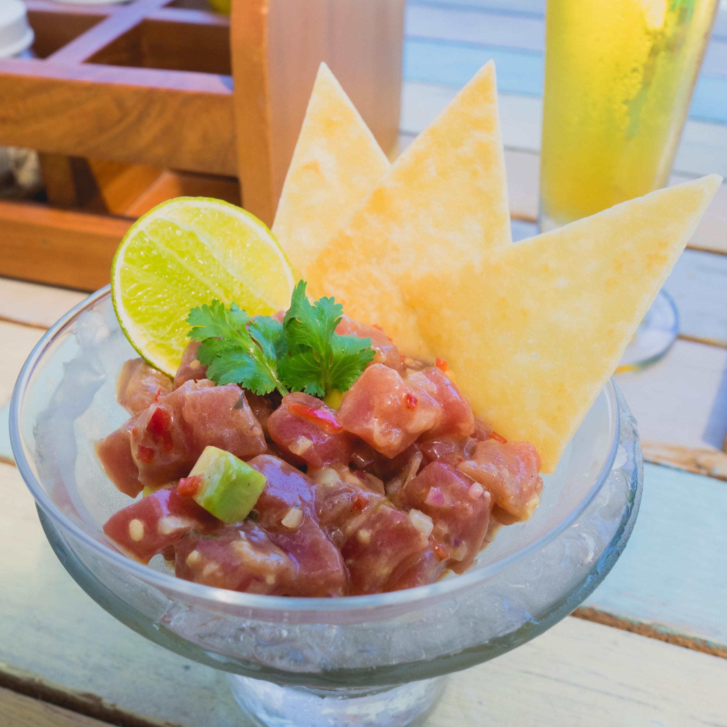 tuna tartare  at lagoon bar with chilli, black pepper, olive oil, shallots, kaffir lime, avocado, tortilla chips.