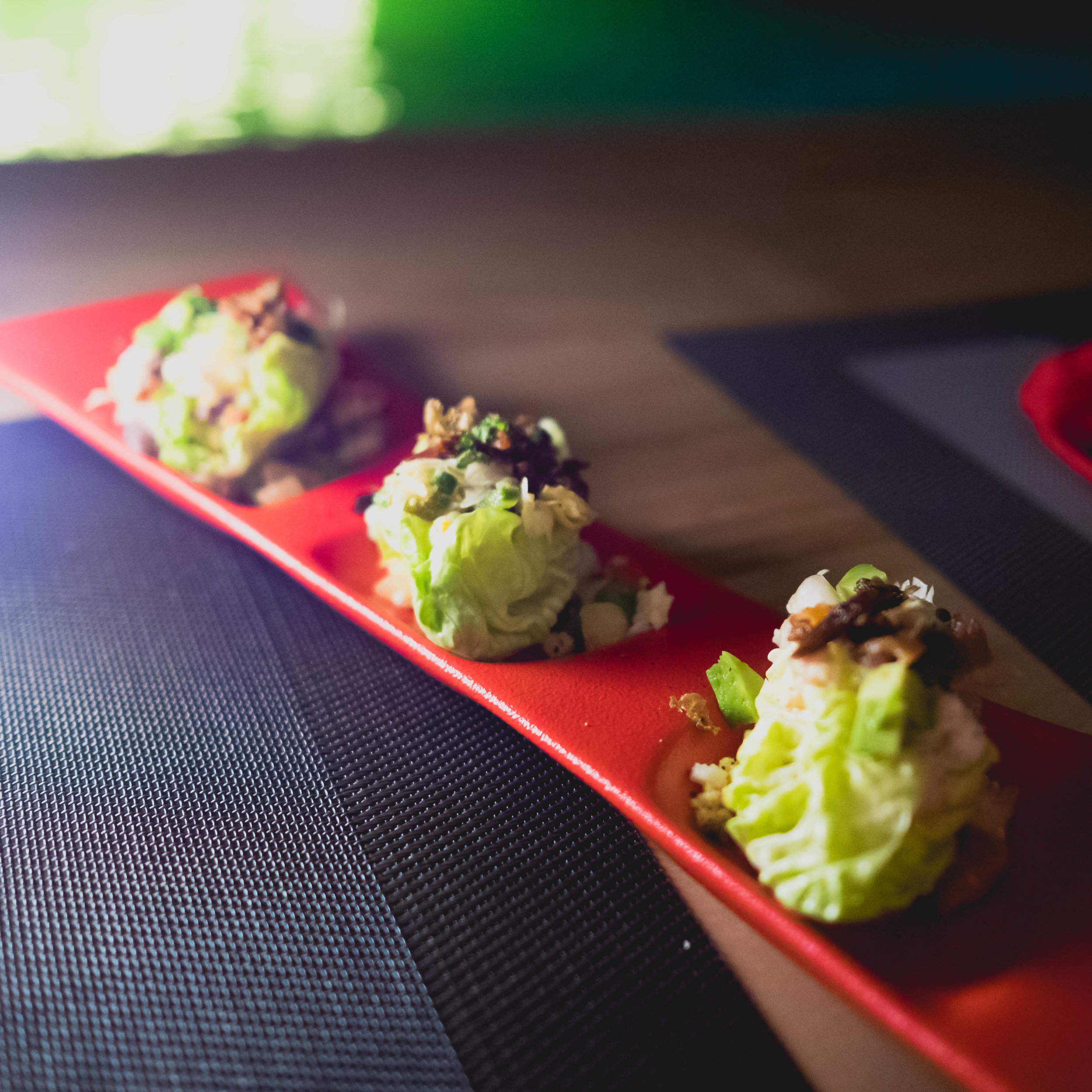 over the top lettuce wedges  with bacon and rance dressing.