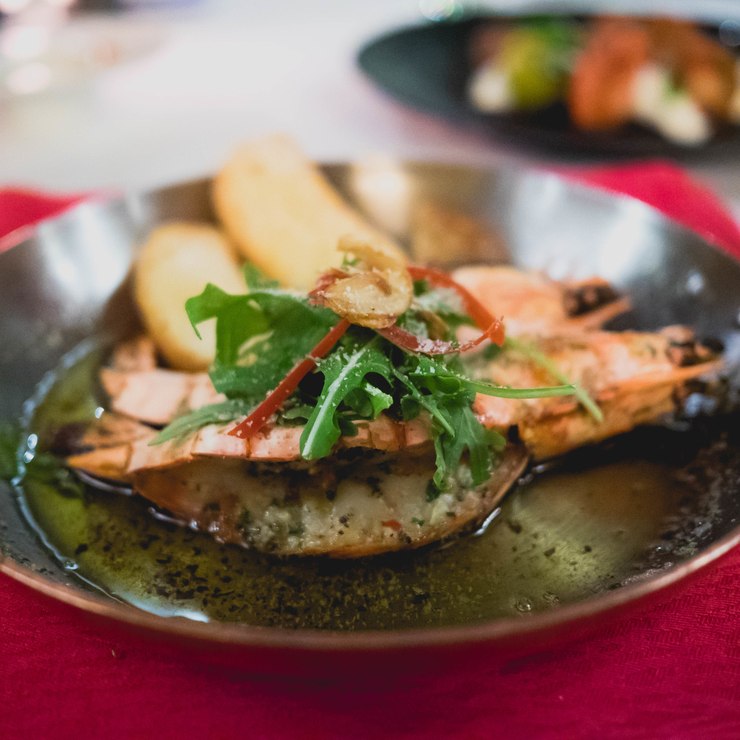 allegria's  2 king prawns from the wood fire oven  with garlic and chili butter and pangritata.
