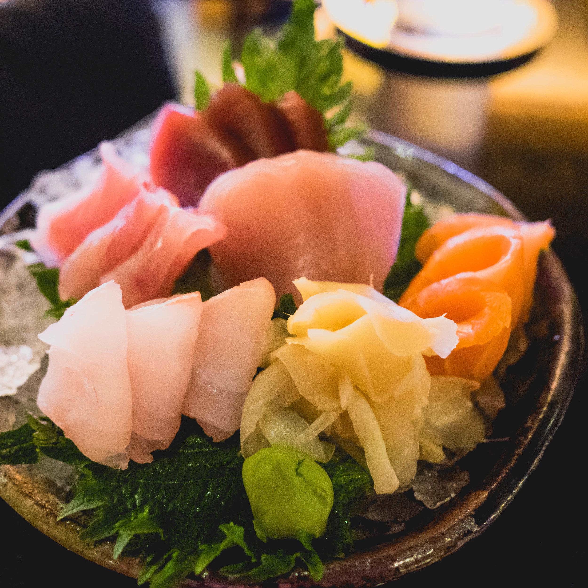 sashimi  of local yellow fin tuna, local wahoo, local snapper, local moon grouper and atlantic salmon at umami .