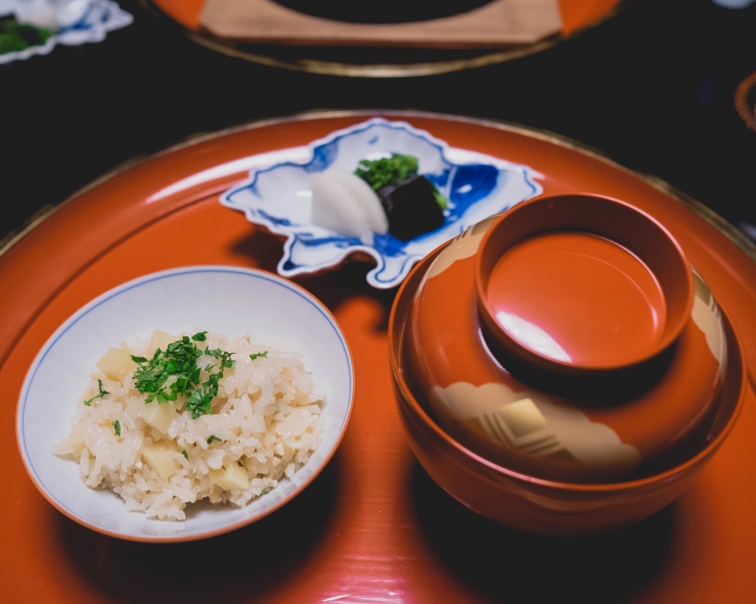 bamboo shoot rice , kinome herb; salt-pickled rapini, pickled daikon radish, salt-cured giant kelp.