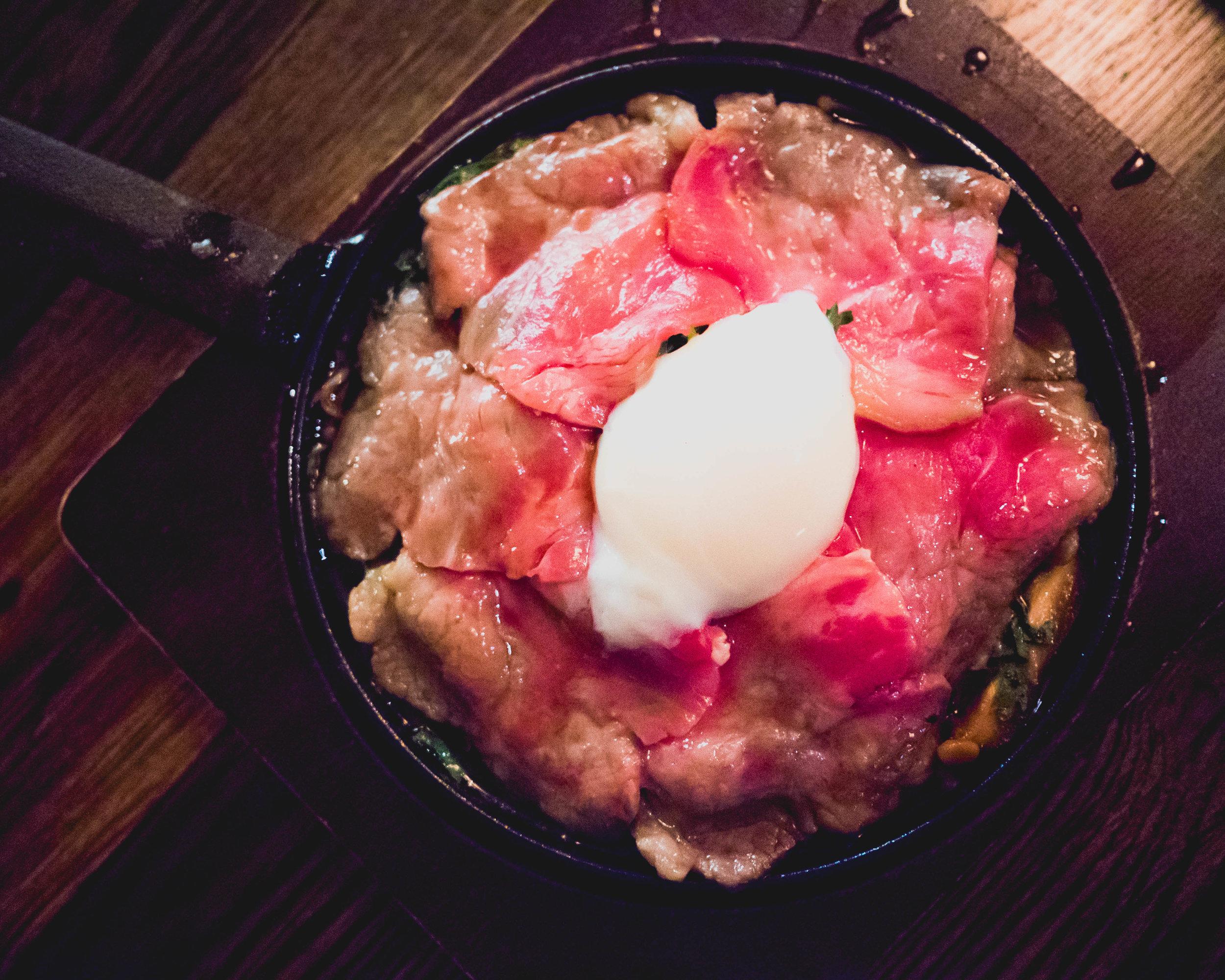 sukiyaki : new york strip steak, forest mushrooms, chrysanthemum leaves, soft egg.