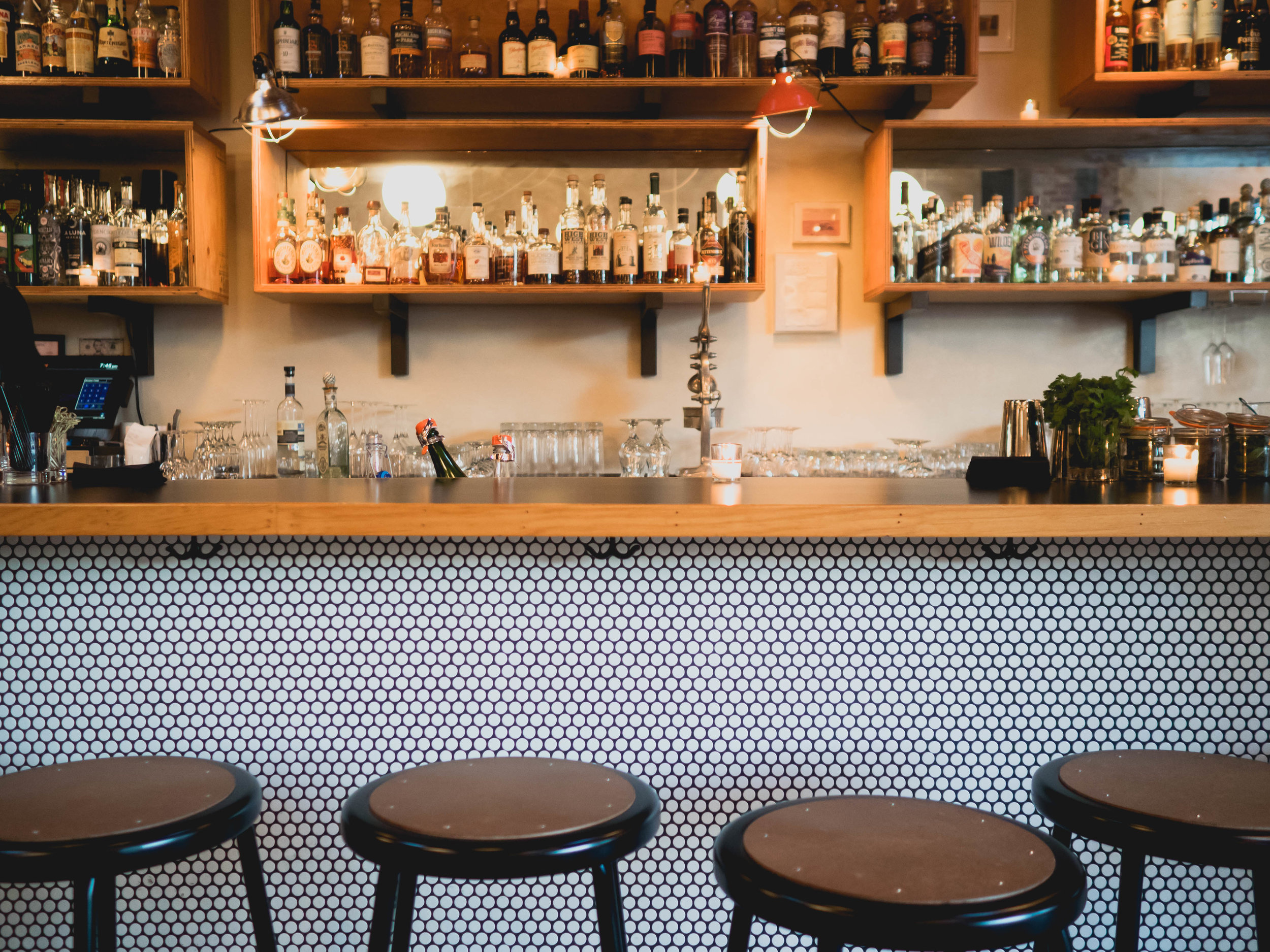 love the penny round tile used on the bar.