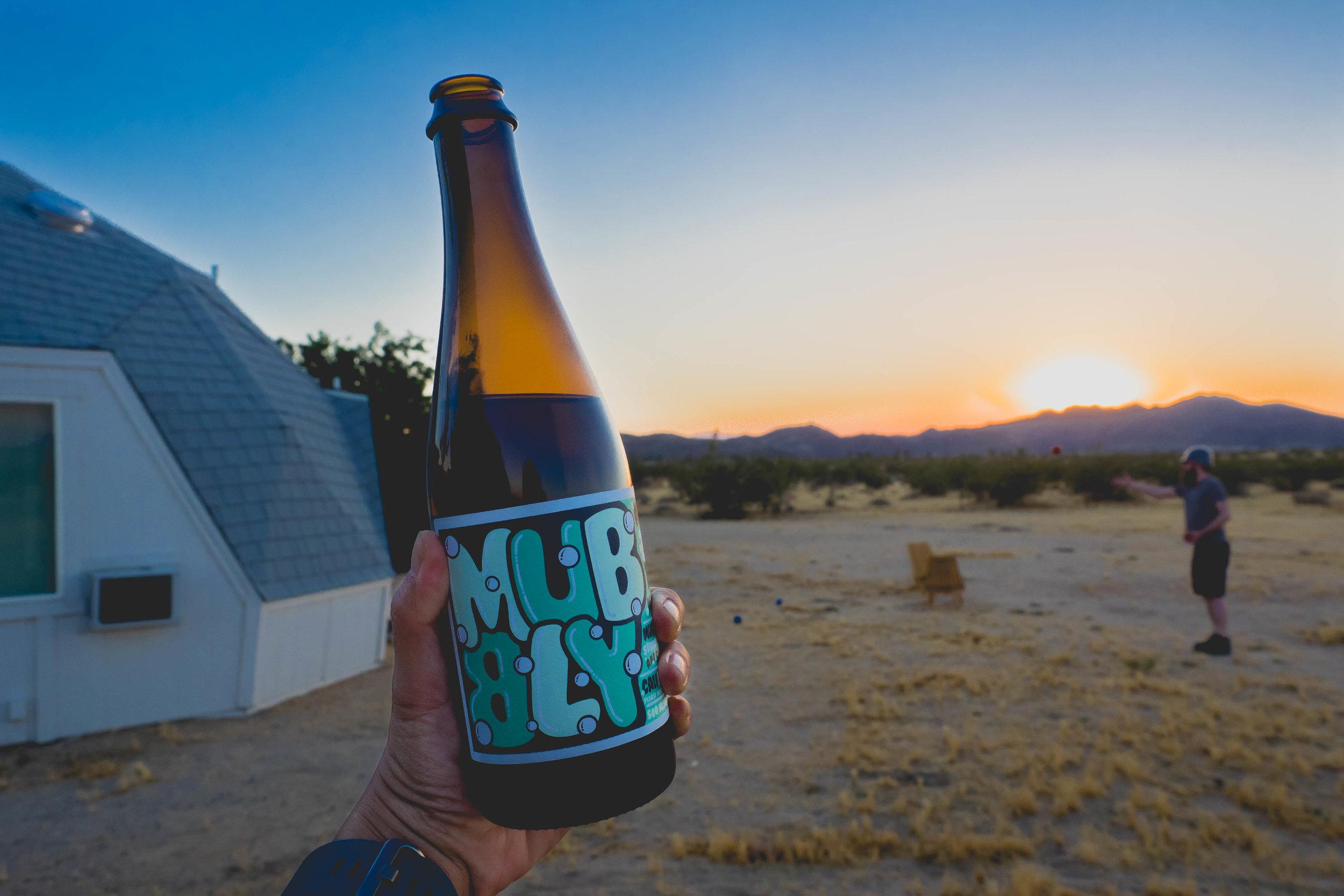 "desert bocce with a bottle of  muni wine ""mubbly"" (mini bubbly)."