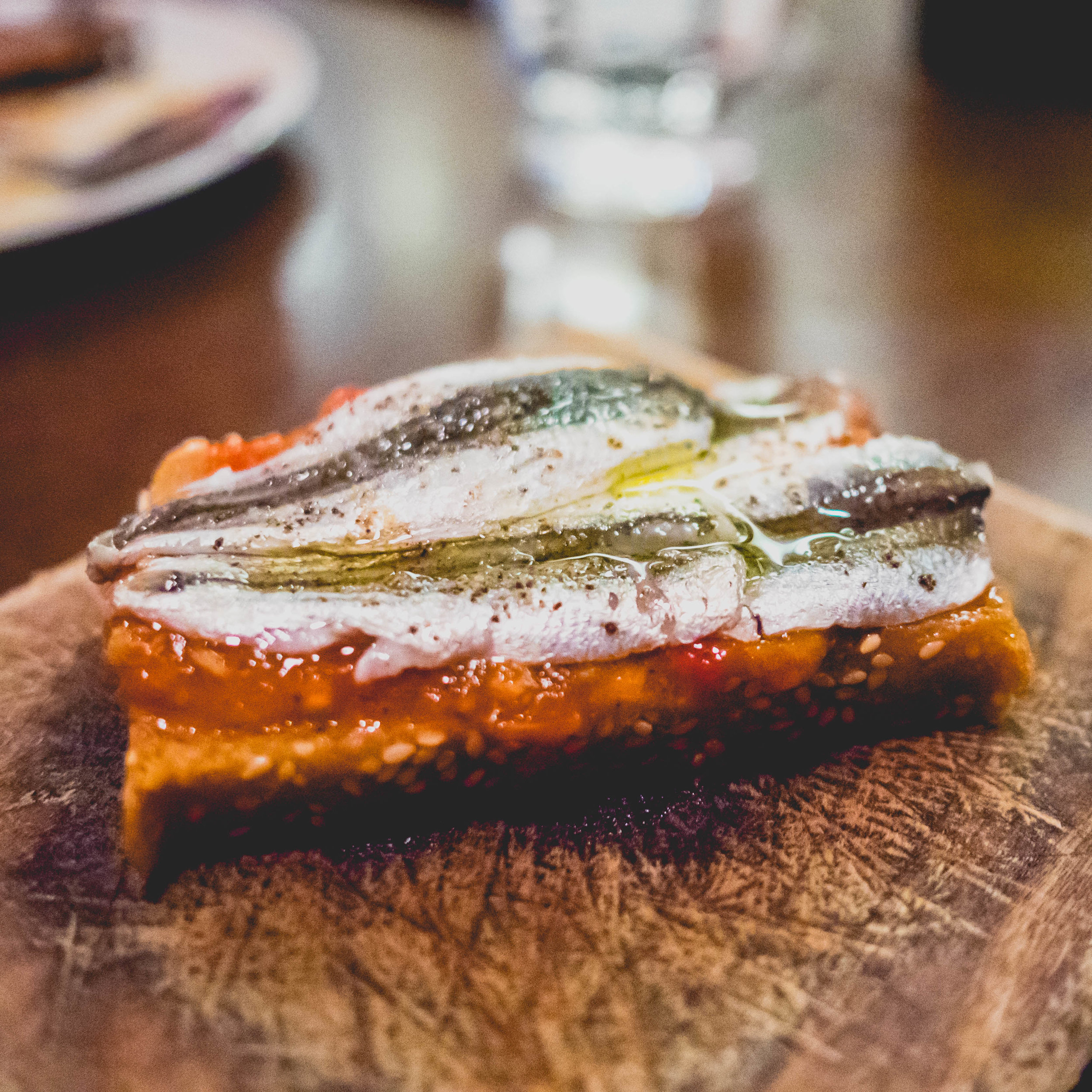 pickled local anchovy tomato toast .