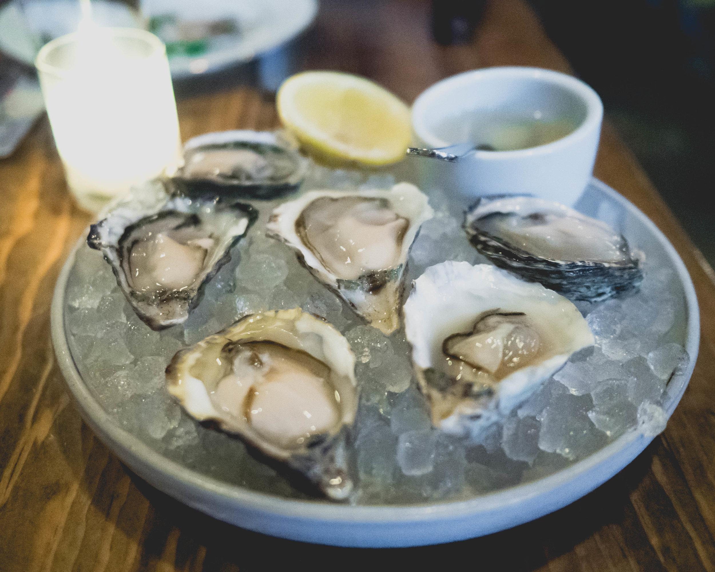 oysters, horseradish vinegar, lemon.
