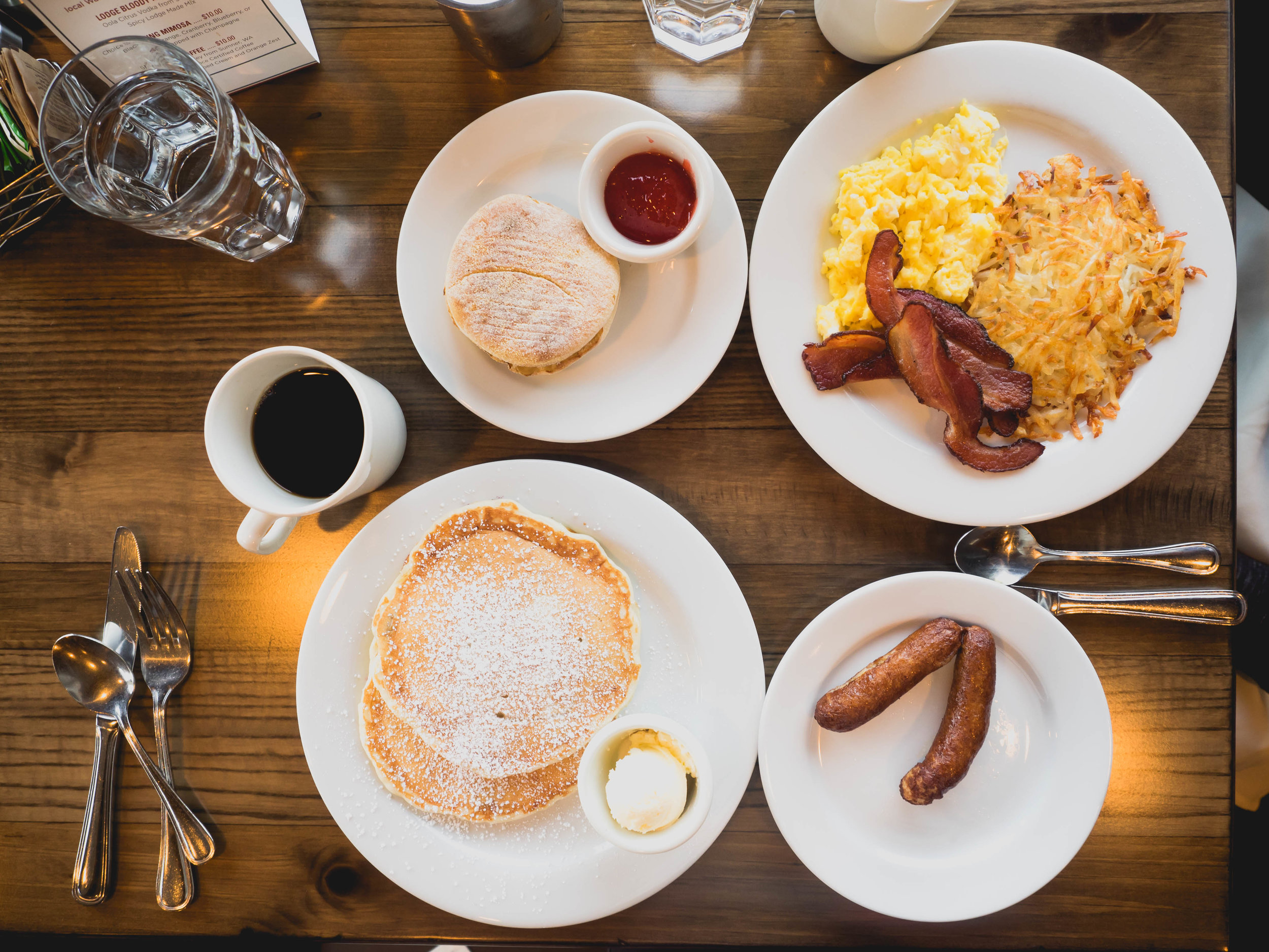 lodge breakfast : two eggs, hash browns, bacon, english muffin;  buttermilk sourdough pancakes , side of chicken apple sausage.