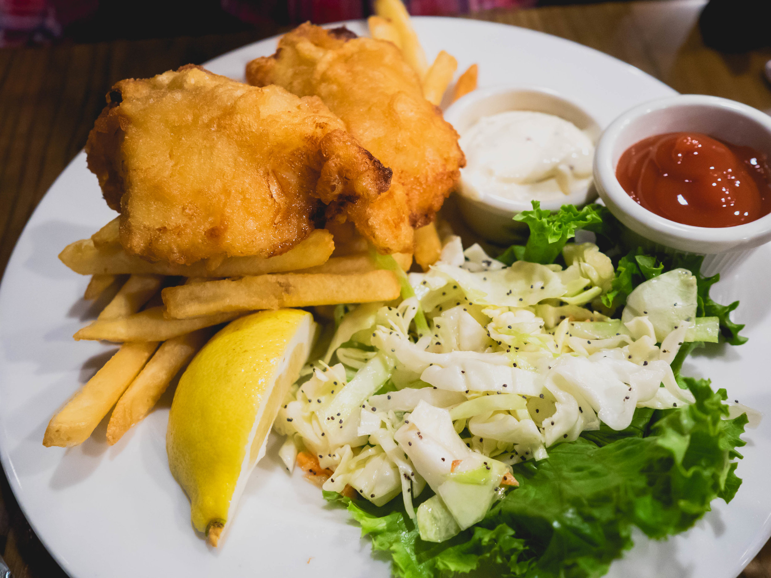 fish and chips : bar hop ale battered pacific cod, citrus tartar sauce, coleslaw, french fries.