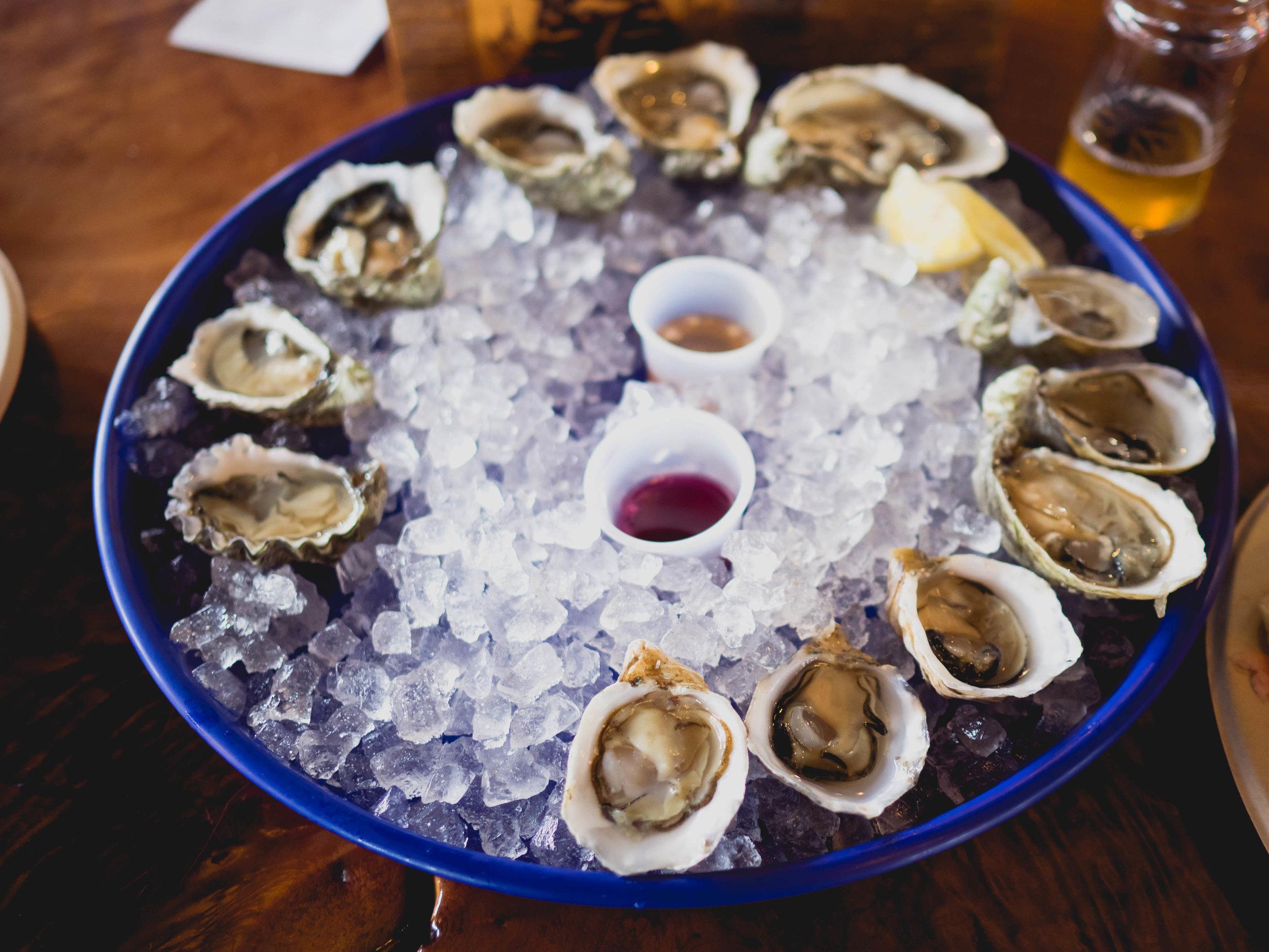 a dozen fresh shucked  oysters .