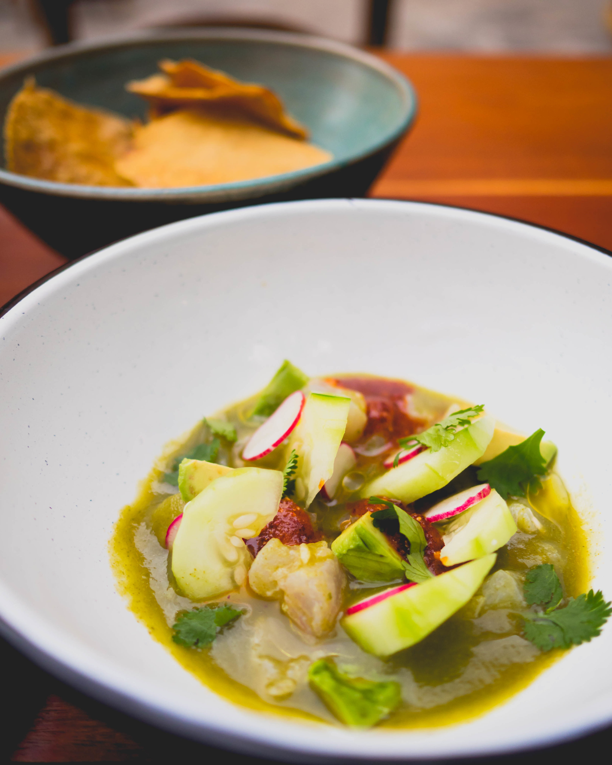 red snapper aguachile , cucumber, red onions, macha, avocado.