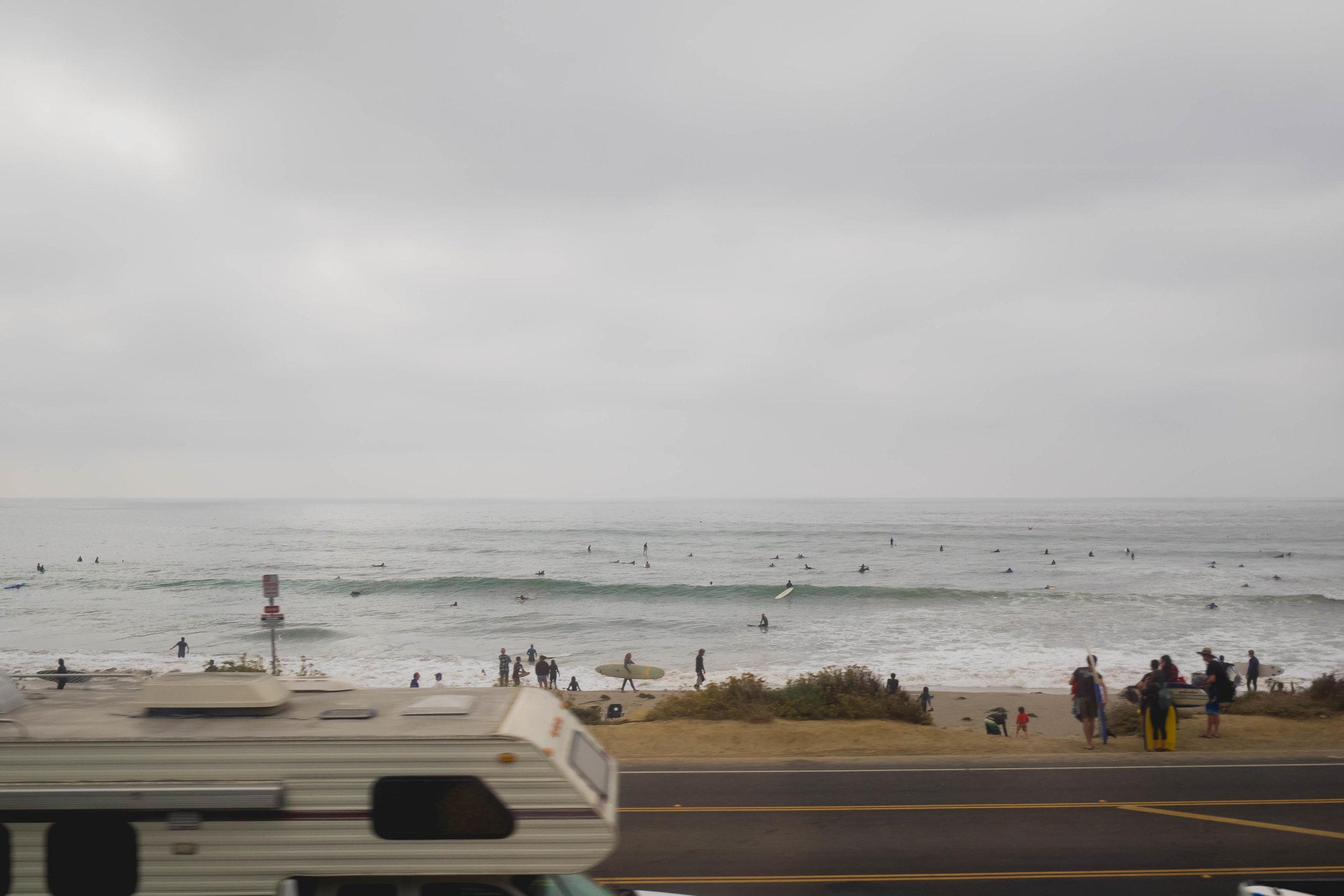 passing a popular surf spot.