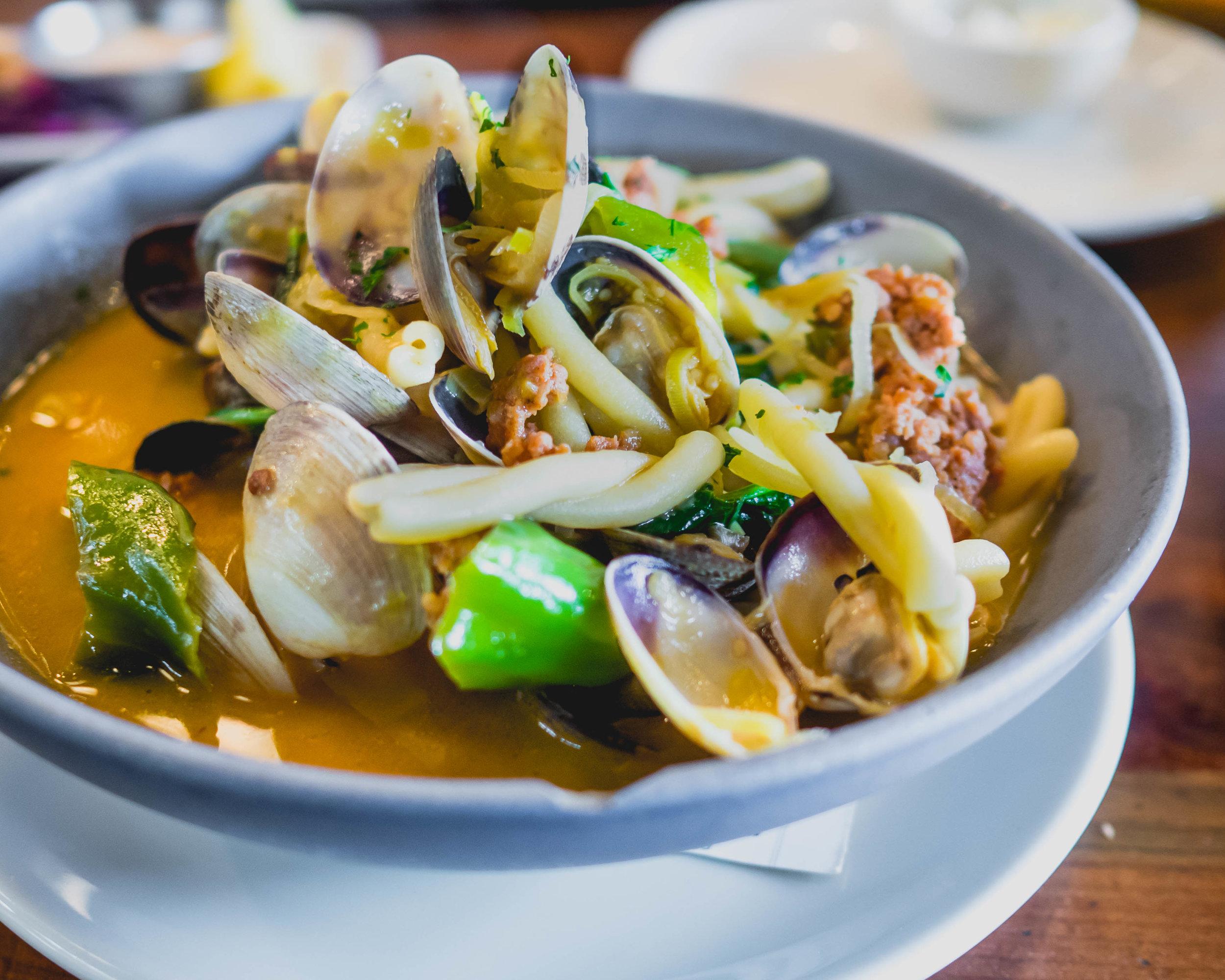 steamers with pasta : manila clams, chorizo, shishito pepper, leek top, tomatillo sauce, white wine, butter.