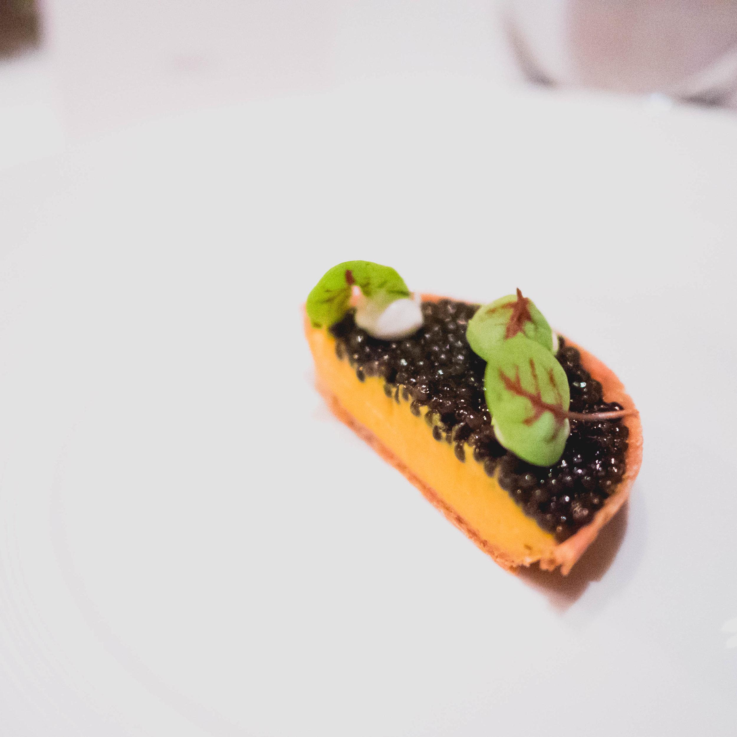tsar nicoulai caviar tartelette  with pumpkin, brown butter, smoked eel.
