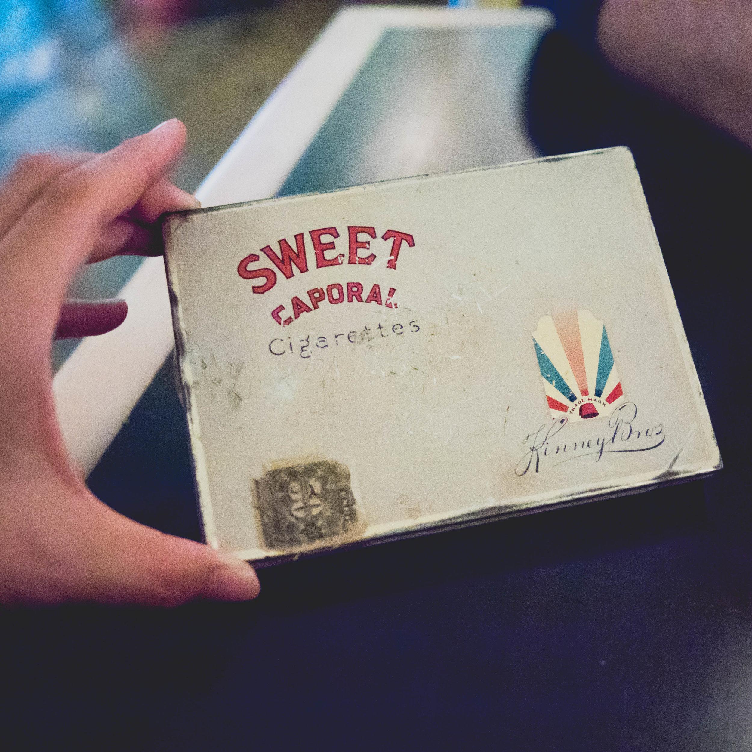 cigarette box for the check.