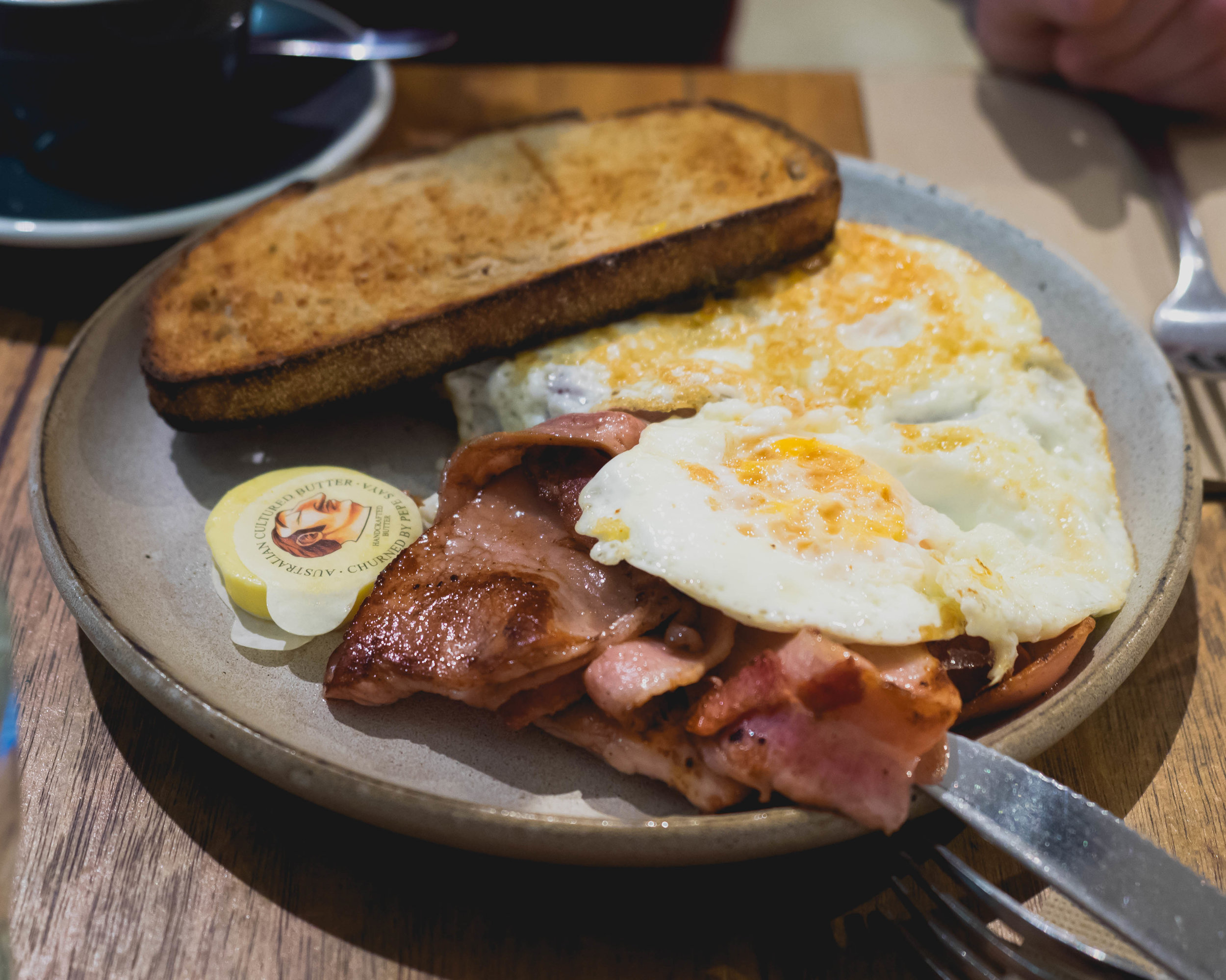 eggs on sourdough  with bacon speck.