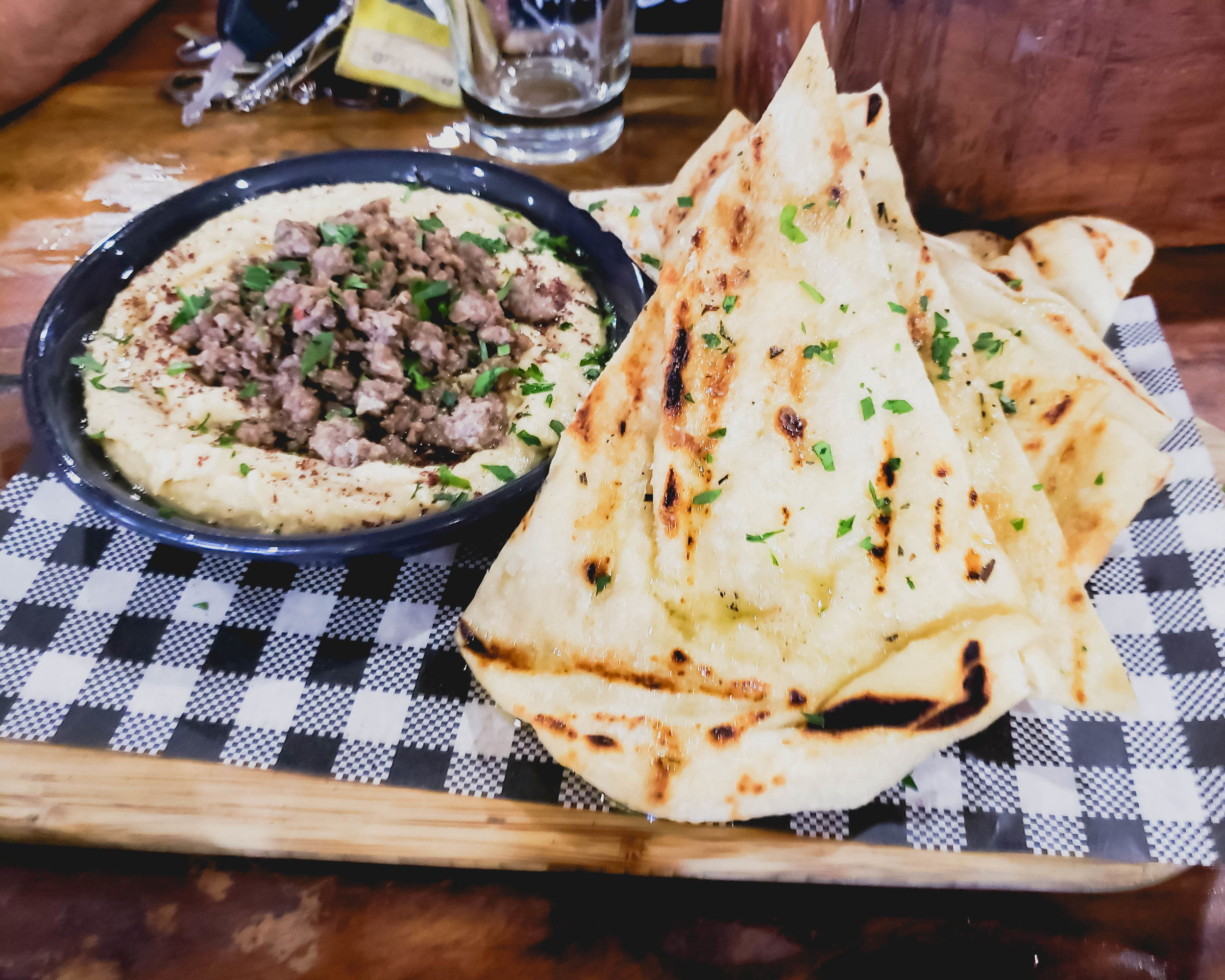 hummus  with sumac, spiced lamb, grilled flatbread.