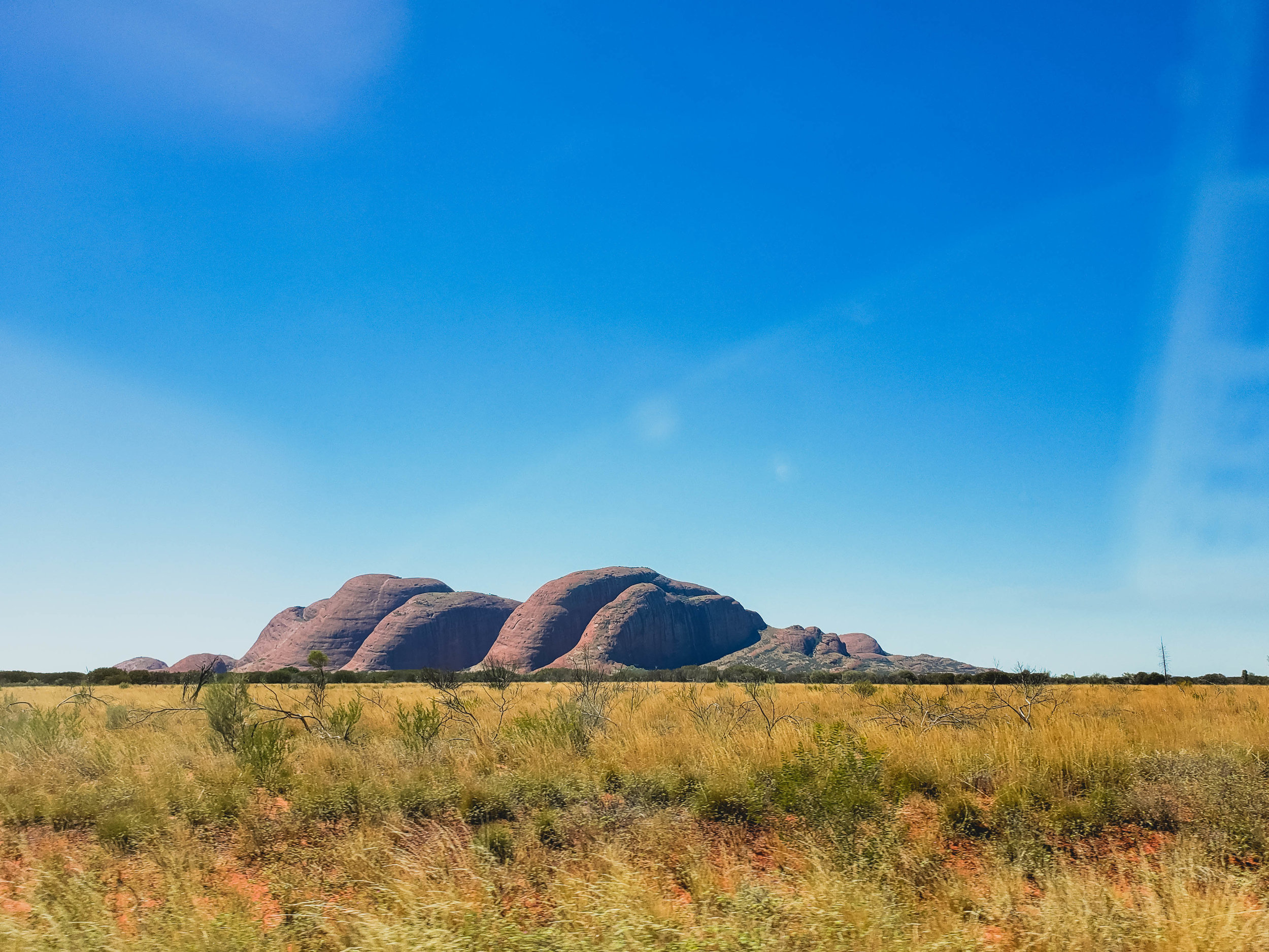 getting closer to kata tjuta, from a different angle.