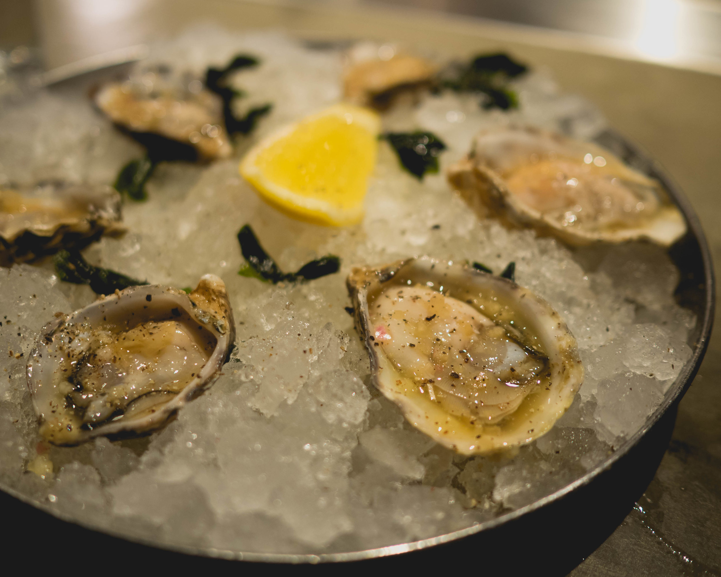 oysters , dashi mignonette, shallot, lemon.
