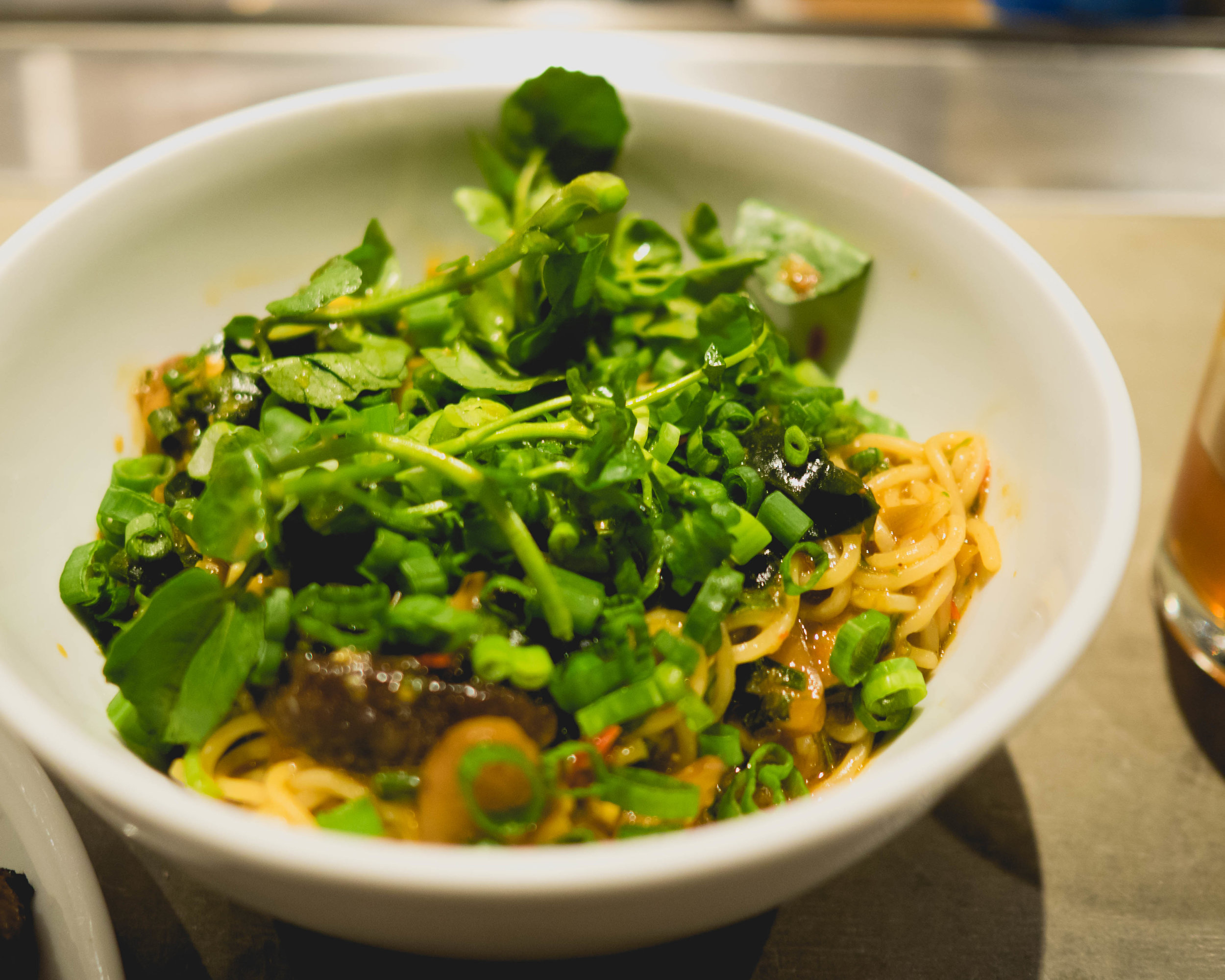 ginger scallion noodles , pickled shiitake, spicy cucumber, wakame.