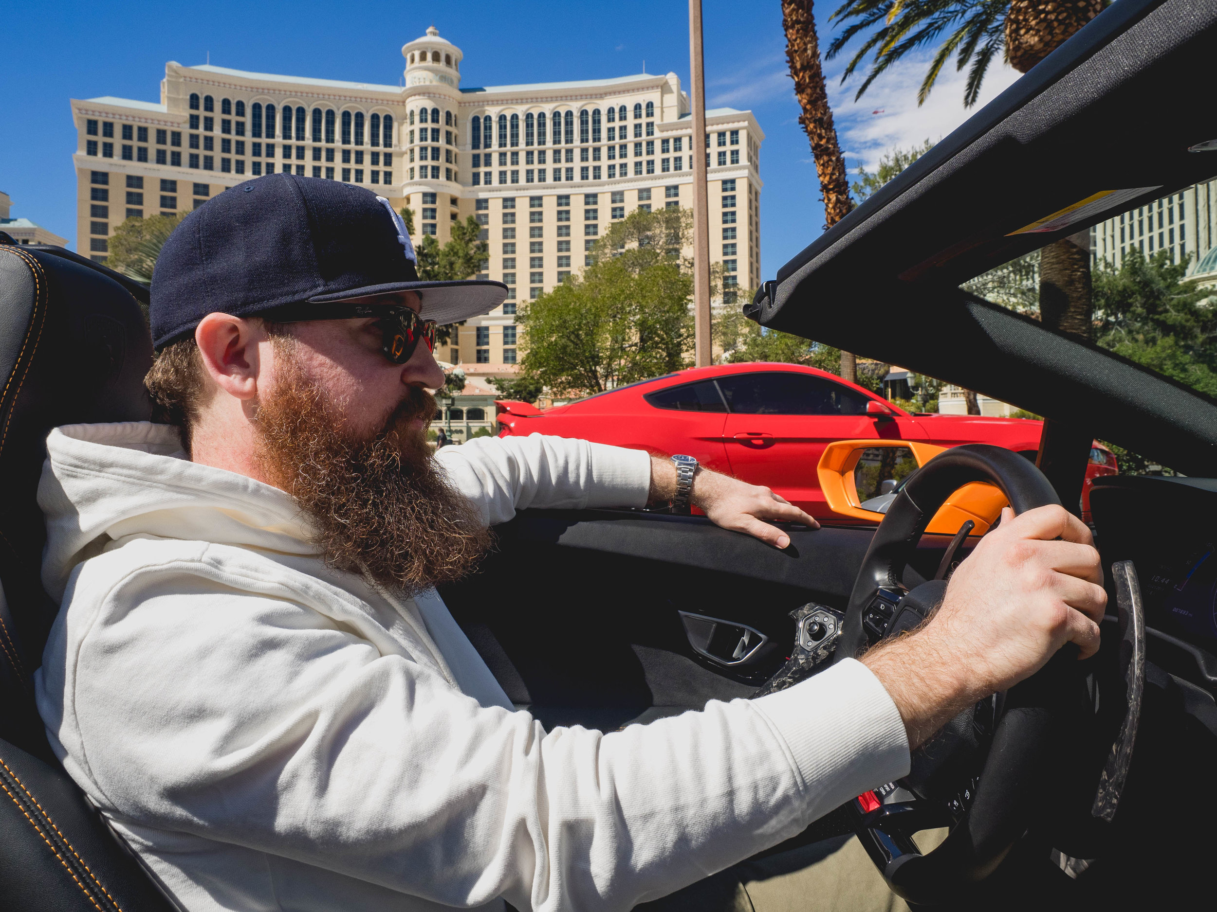 james driving the huracan down the las vegas strip, with  the bellagio  behind him.
