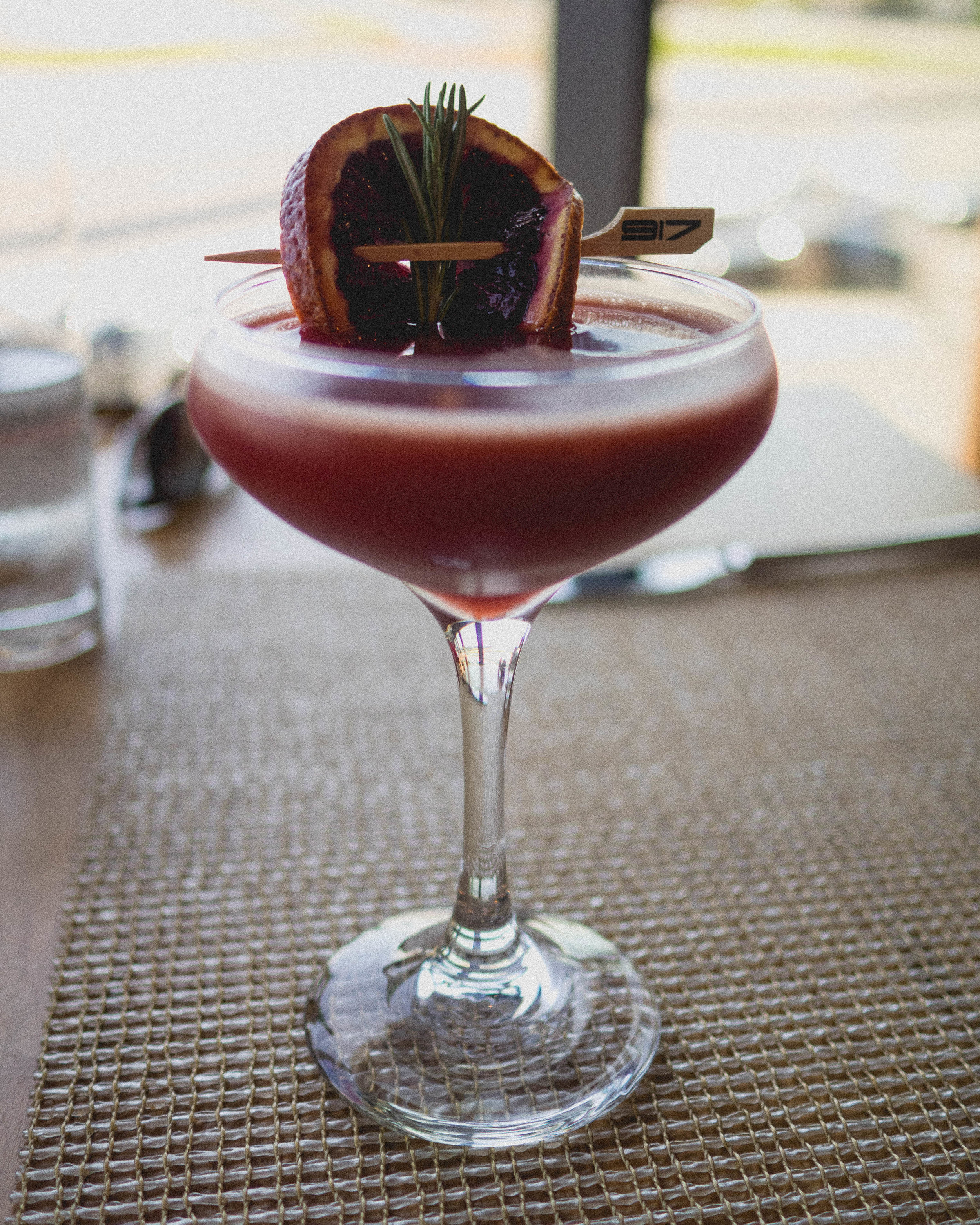 porsche travel experience - scotland  with macallan 12, blood orange, cassis liquor, rosemary, orange peel.