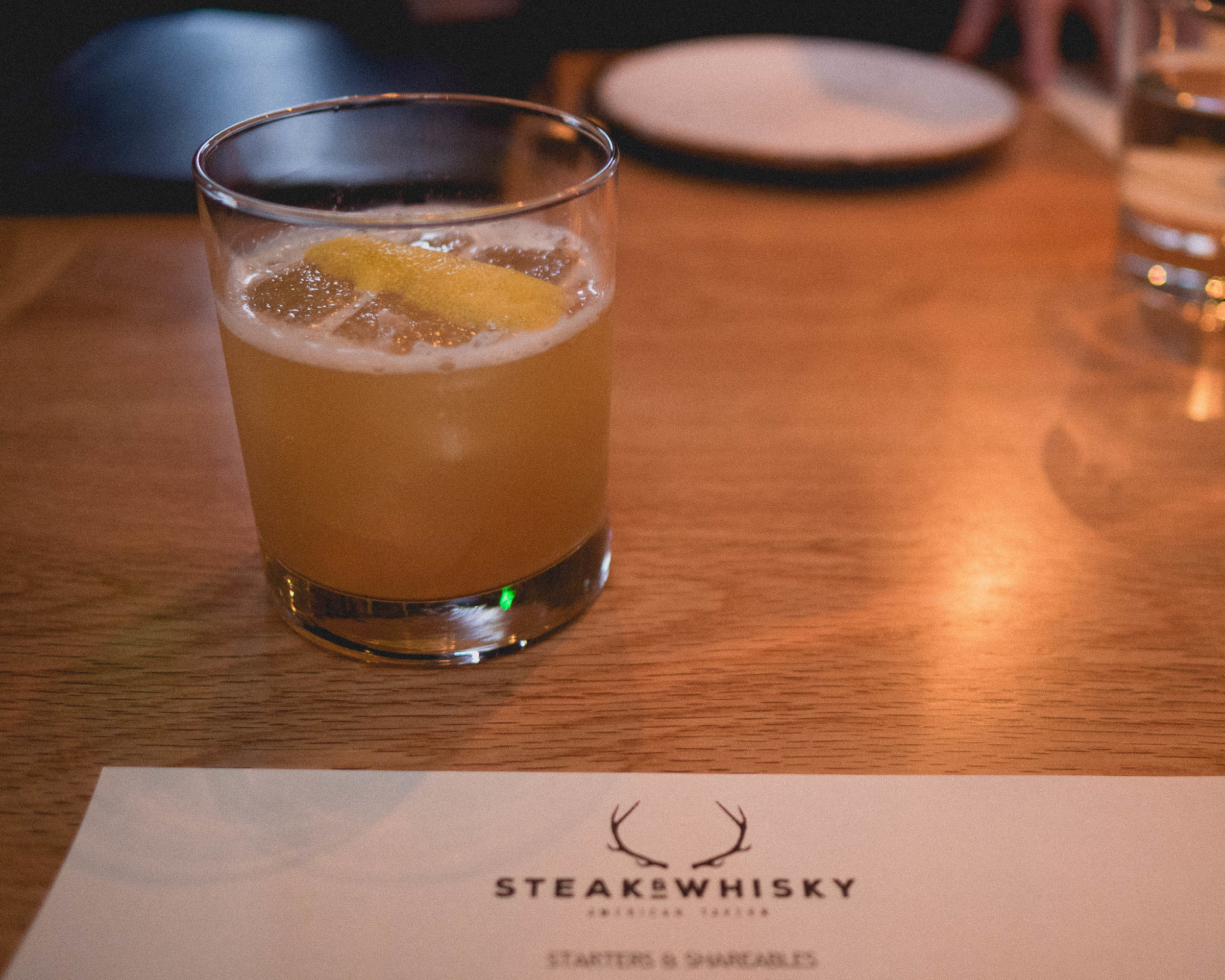 southern gold : uncle nearest whisky, yuzu, muddled ginger, honey.