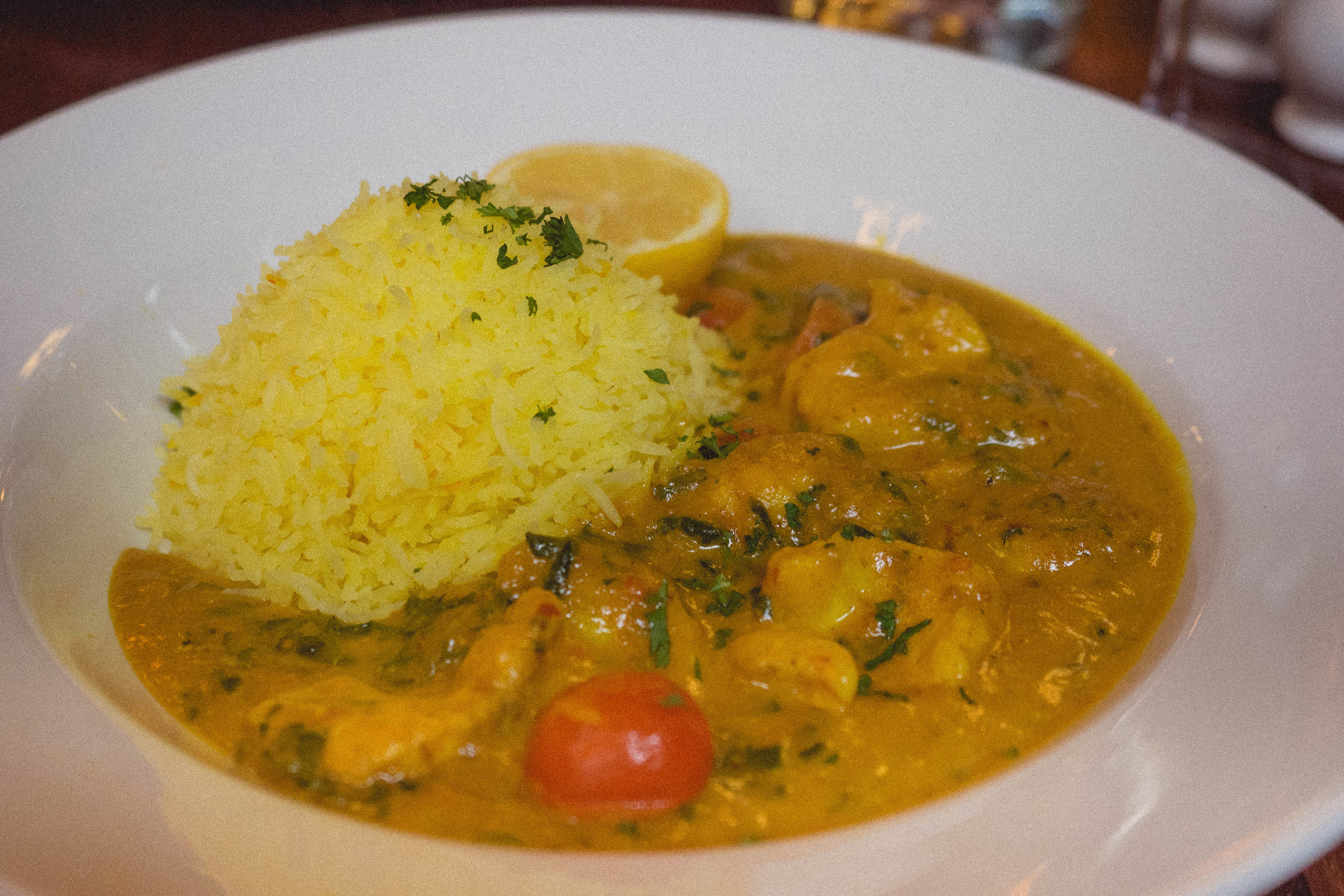 scottish monkfish fillet, goan tomato and coconut curry, saffron rice.