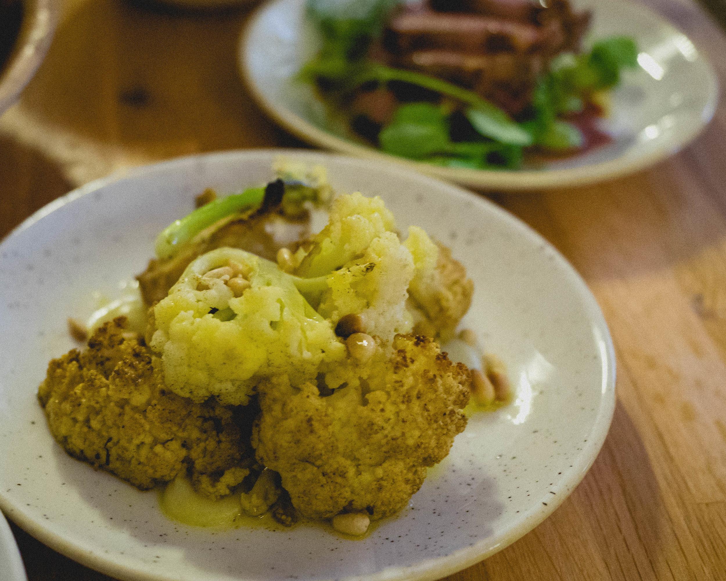 roasted jerk cauliflower , curried puree, pine nut dressing.