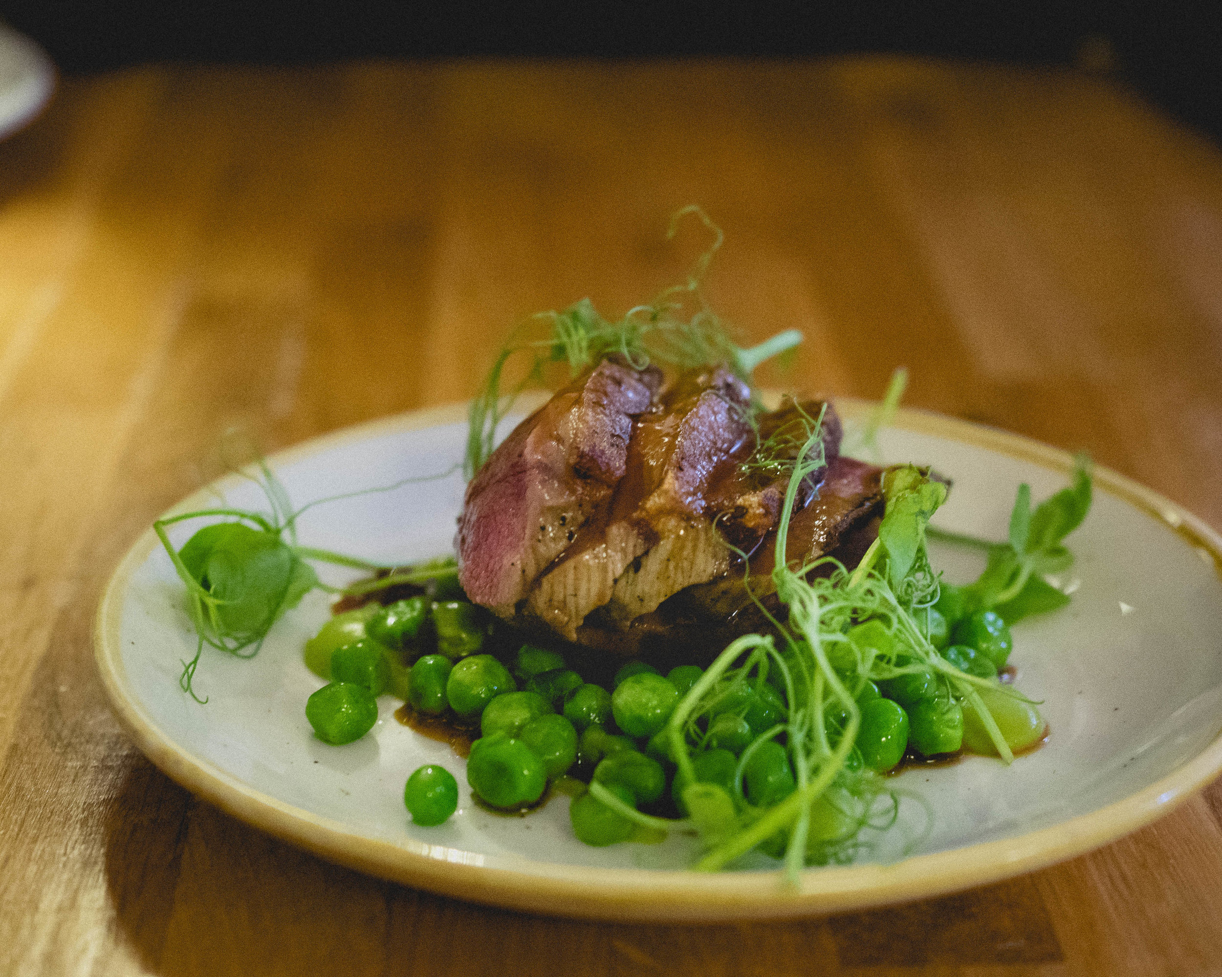 roast lamb loin , pea and broad bean fricassee, madeira jus.