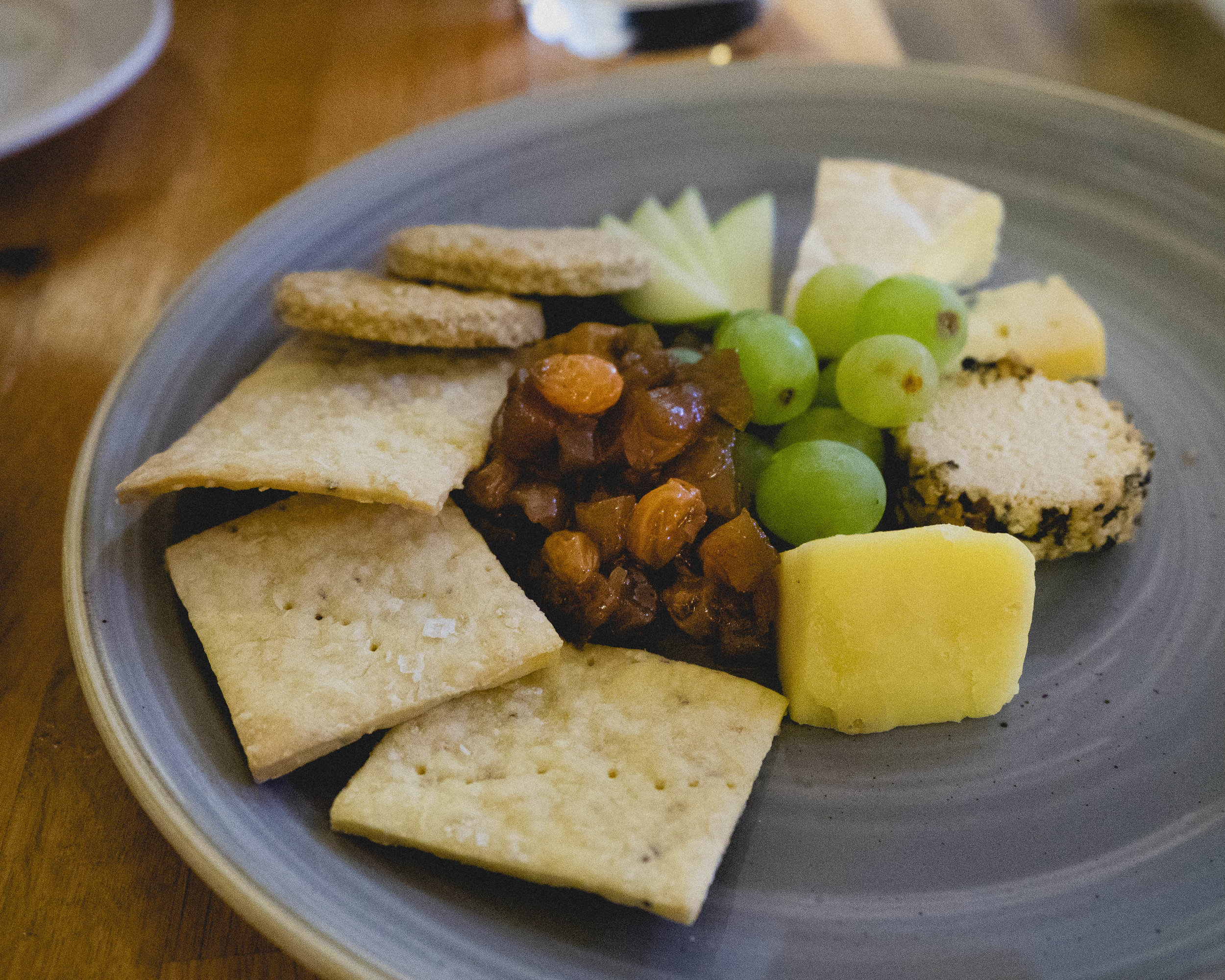 selection of scottish cheese , chutney, biscuits, fruit.