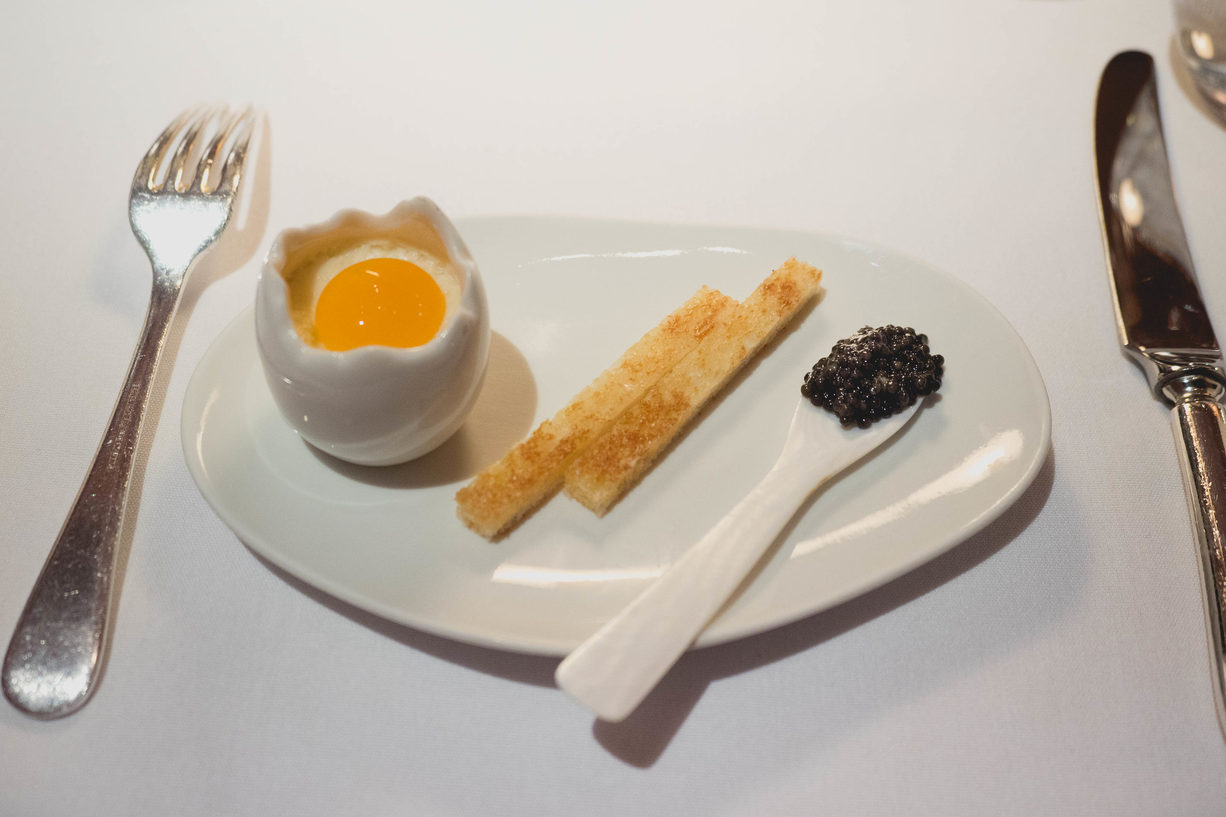 eggs and soldiers : comte cheese mornay, 63 degree egg yolk, comte cheese soldiers, sturgeon caviar.