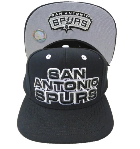 SPURS: CAP- BLK W/SAN ANTONIO SPURS ON FRONT & TEAM NAME & LOGO ON BOTTOM OF BRIM- SNAPBACK- STYLE XZ797- ONE SIZE FITS MOST