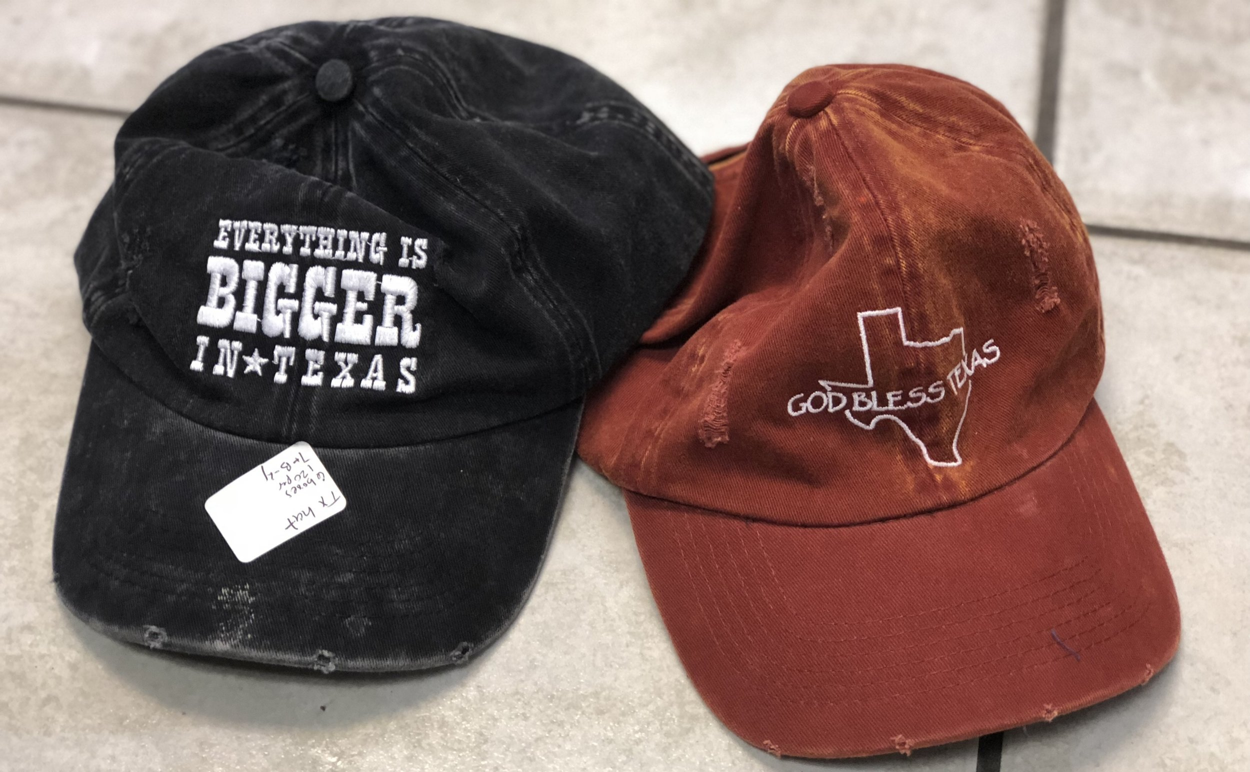 """EVERYTHING IS BIGGER IN TEXAS"" & ""GOD BLESS TEXAS"" BALL CAPS, 6 BOXES 120 PER"