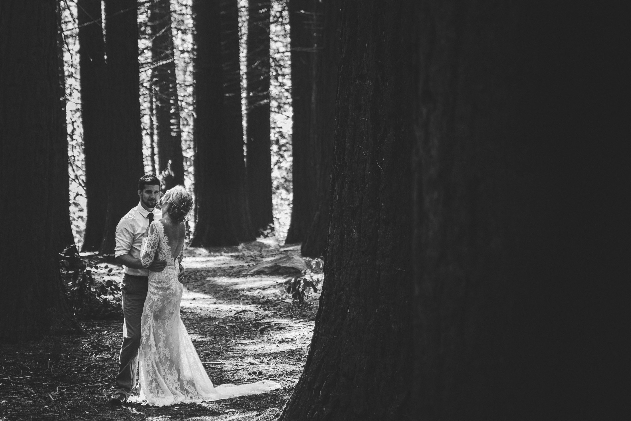 A whimsical styled wedding in the redwood Forest. Featuring a lace sheath gown, wild flowers and a deep connection. Based In Vancouver, BC. Photography By Mimsical Photography |Dress Designer: Calla Blanche | Bridal Boutique: Everything But the Groom | Make up: Jaymie Dekker  #whitewedding #casualwedding #bohemianwedding #woodlandwedding #lacegown #sheathgown #white #whitebouquet #wildflowerbouquet #messyupdo #relaxedupdo #redlips #babysbreath #dahlia #wedding #bride #groom #bridalportrait #emotionalphotography #connectionphotography #woodland #redwood #trees #musthave #moodywedding #vancouverwedding #vancouverbc #weddingdress #weddinginspo #bridalinspo #beards #beardedgroom