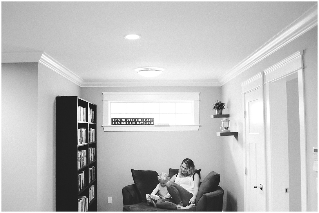 pregnant mother reading books with toddler  #documentaryphotography #lifestlyephotography #vancouver #langley #fraservalley #mother #father #kids #trampoline #jenga #booknook #lifestyle #inhome #fall #familyof5 #fourthbaby #maternity #reading #whitekitchen #activefathers #playwithyourkids