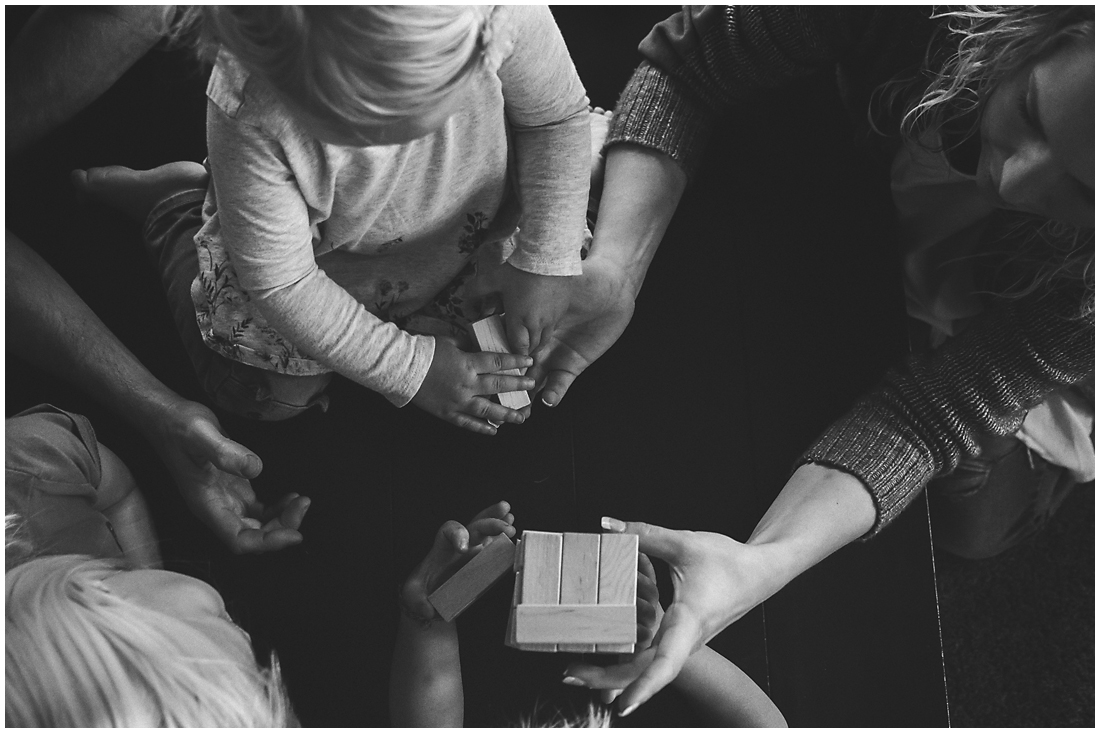family playing jenga photographed from above  #documentaryphotography #lifestlyephotography #vancouver #langley #fraservalley #mother #father #kids #trampoline #jenga #booknook #lifestyle #inhome #fall #familyof5 #fourthbaby #maternity #reading #whitekitchen #activefathers #playwithyourkids