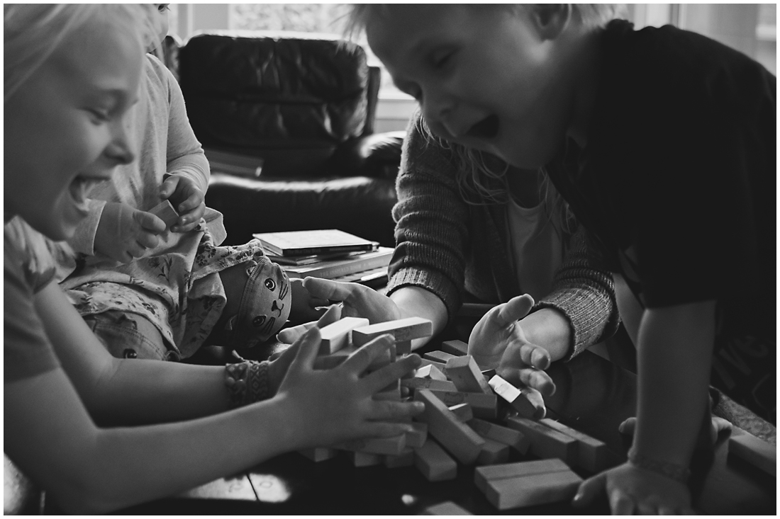jenga tower fallen over with kids  #documentaryphotography #lifestlyephotography #vancouver #langley #fraservalley #mother #father #kids #trampoline #jenga #booknook #lifestyle #inhome #fall #familyof5 #fourthbaby #maternity #reading #whitekitchen #activefathers #playwithyourkids