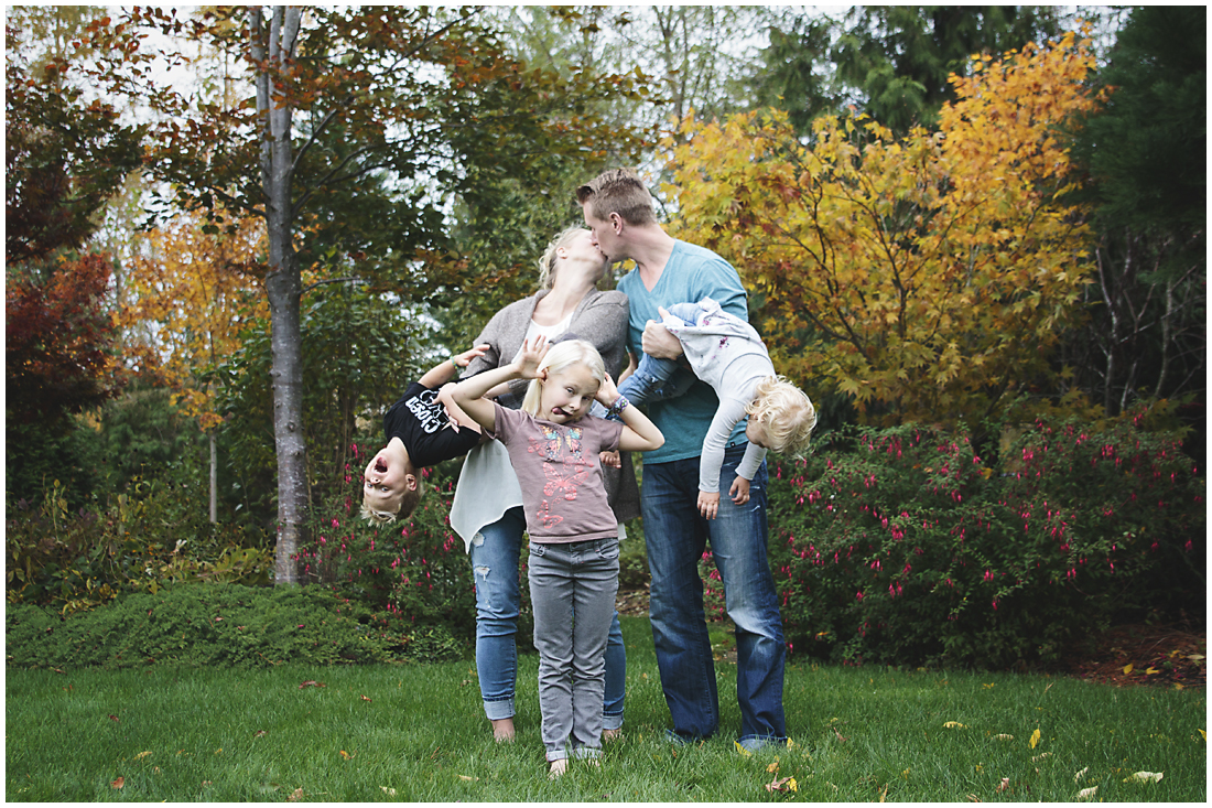 unposed portrait of a family of five - two adults and three children - laughing and being crazy with funny faces  #documentaryphotography #lifestlyephotography #vancouver #langley #fraservalley #mother #father #kids #trampoline #jenga #booknook #lifestyle #inhome #fall #familyof5 #fourthbaby #maternity #reading #whitekitchen #activefathers #playwithyourkids