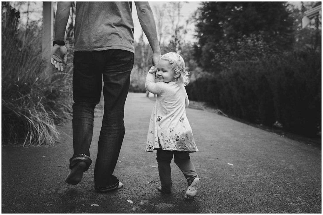 father and daughter walking down driveway holding hands  #documentaryphotography #lifestlyephotography #vancouver #langley #fraservalley #mother #father #kids #trampoline #jenga #booknook #lifestyle #inhome #fall #familyof5 #fourthbaby #maternity #reading #whitekitchen #activefathers #playwithyourkids