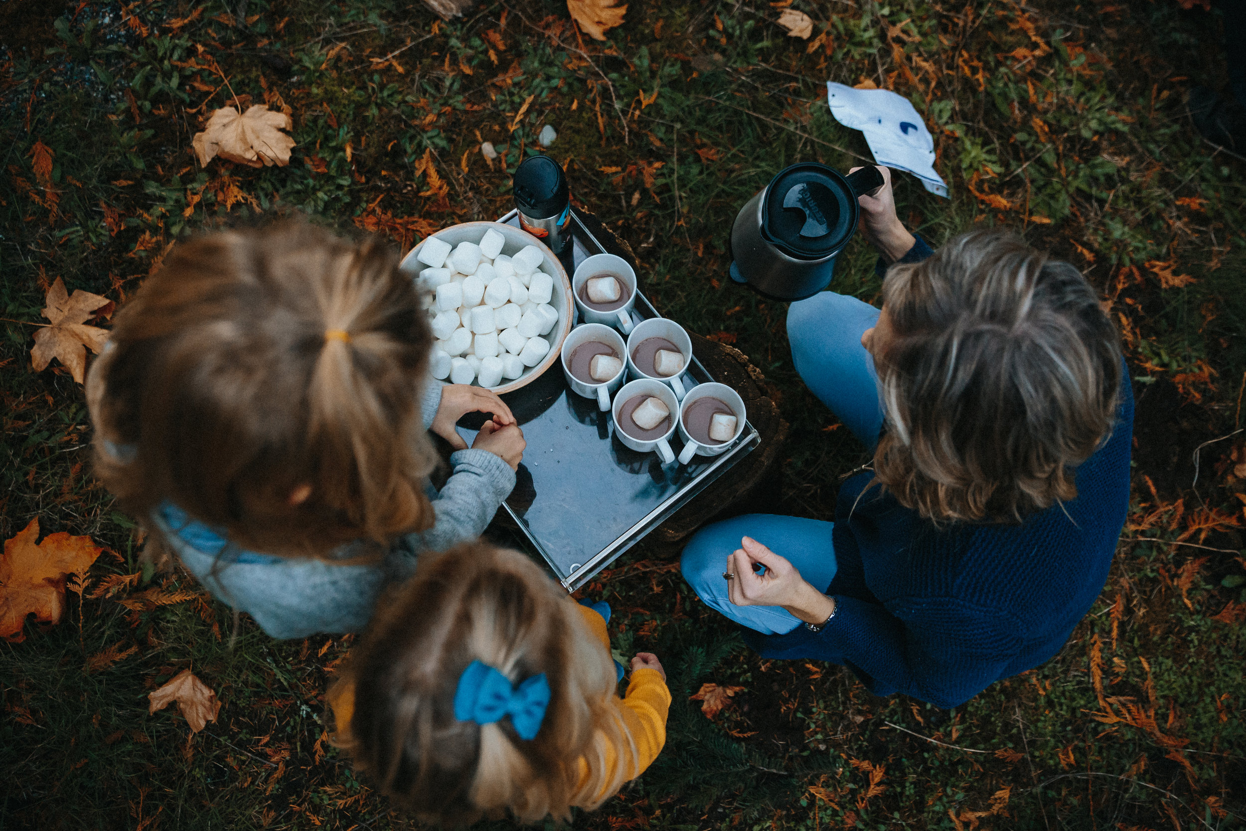 Hot chocolate and marshmallow in fall. Backyard Family Roasting Marshmallows, 4 kids, navy blue, mustard yellow, jean . Real moments, real memories. sticky fingers, documentary lifestyle photography by Mimsical photography, Fraser Valley, British Columbia, Langley, Vancouver.