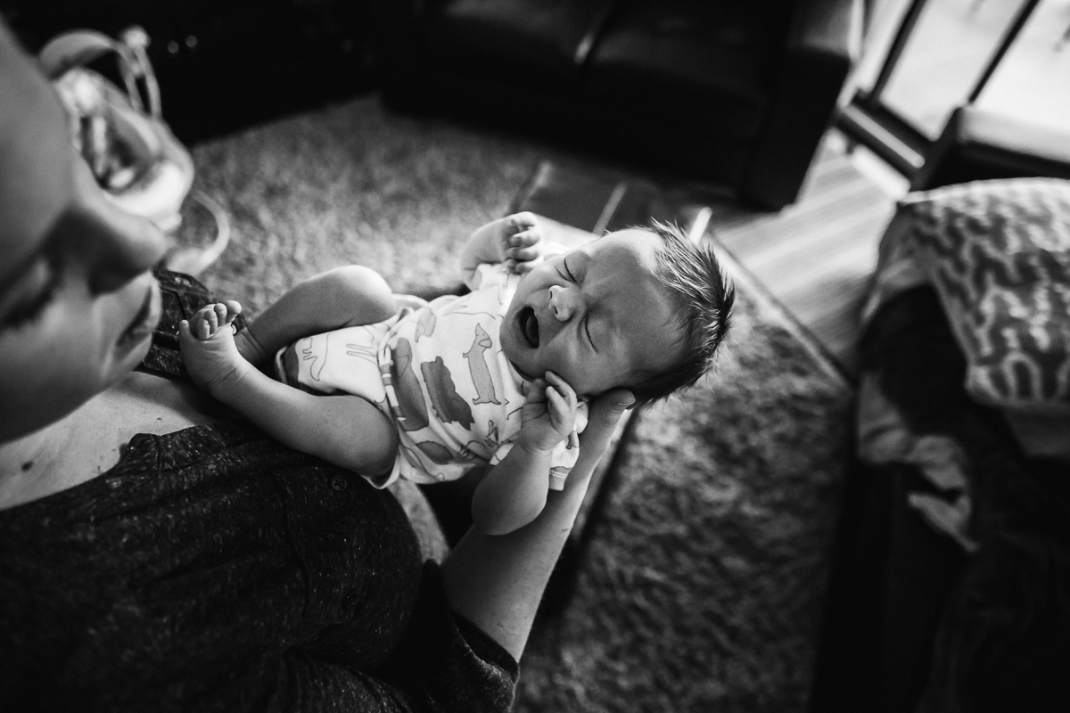 Baby yawns, black and white.   In home documentary newborn session. Mimsical Photography, White Rock, British Columbia #newborn #lifestyle #documentary #reallife #babyboy #nursery #black #apartment #firstbaby #christmas #newparents