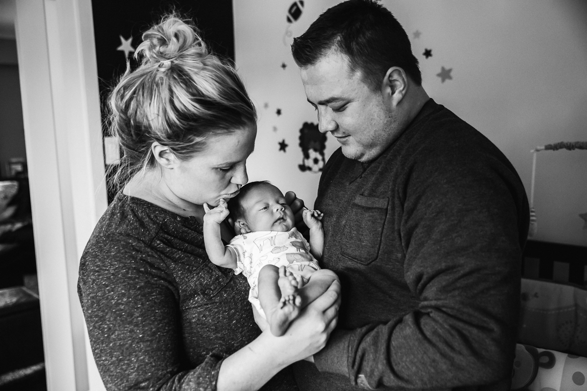 In home documentary newborn session. Mimsical Photography, White Rock, British Columbia #newborn #lifestyle #documentary #reallife #babyboy #nursery #black #apartment #firstbaby #christmas #newparents