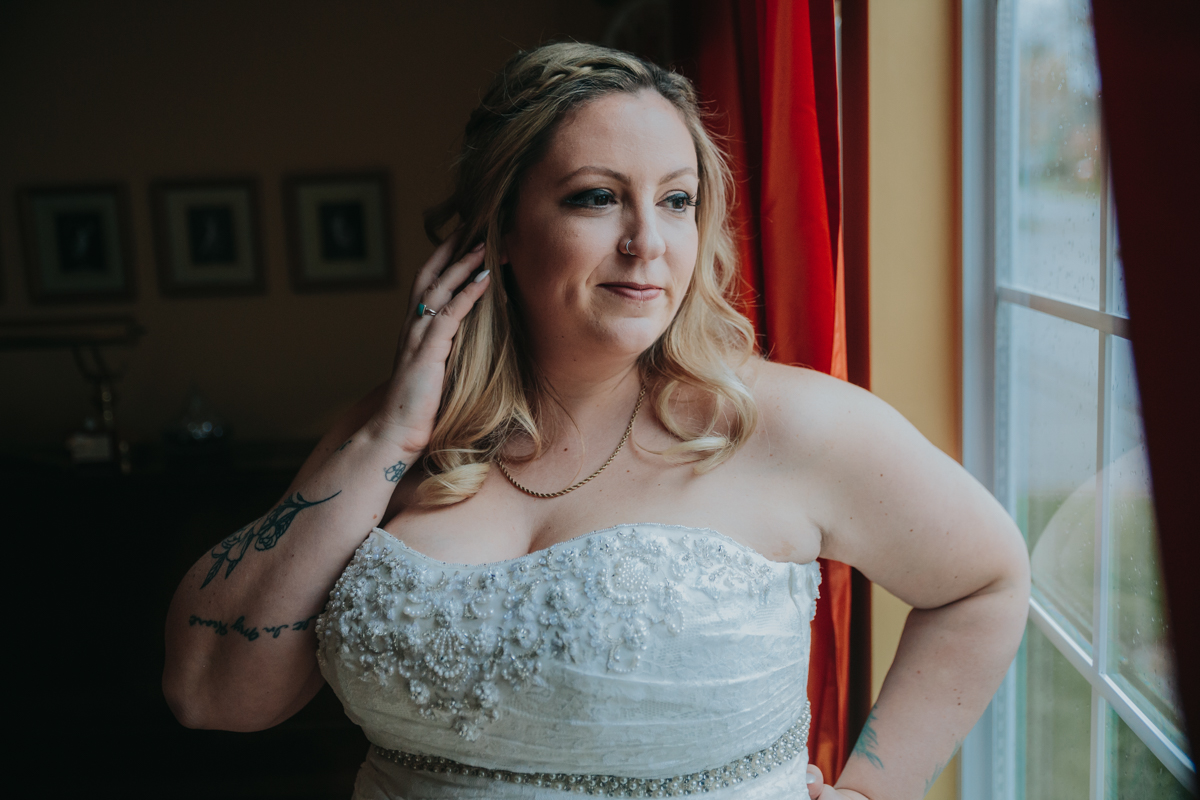 Bride portrait before she leaves for wedding wedding by mimsical photography