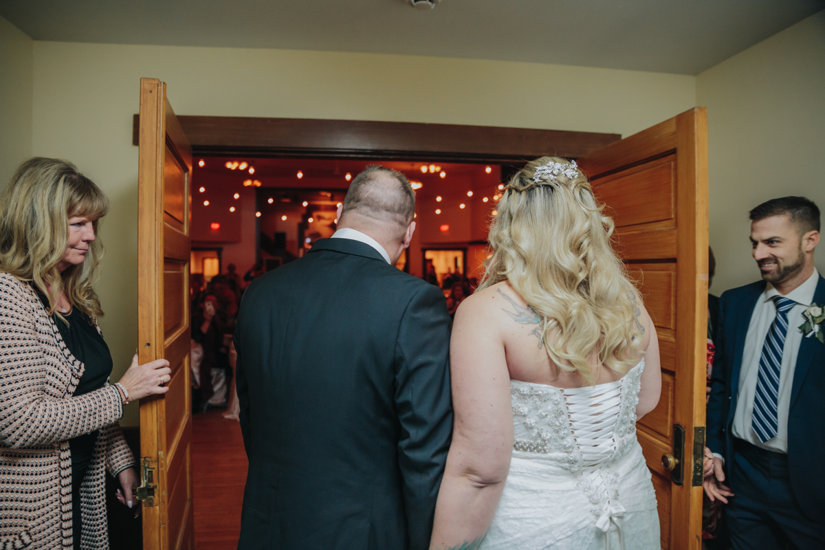 Bride and Groom Surprise Wedding Entrance at East Delta Hall wedding by mimsical photography