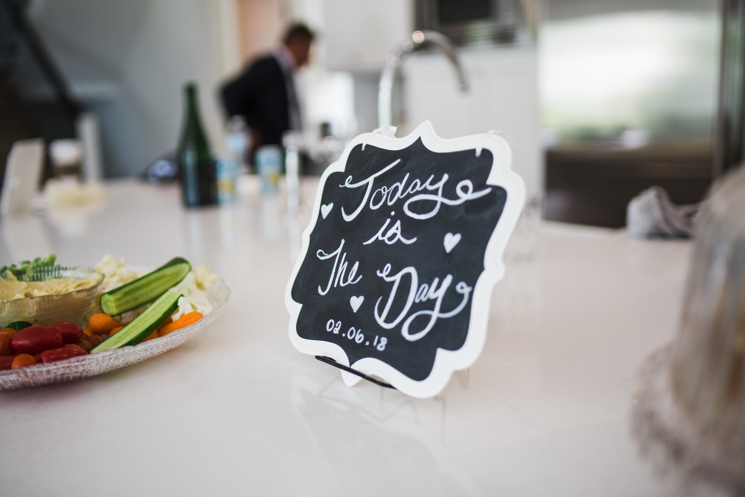 today is the day wedding sign on kitchen sink before outdoor summer wedding at Kwomais Point Park in Ocean Park Surrey British Columbia by Mimsical Photography who is a wedding photographer from Langley, BC that has a candid and documentary fun style.