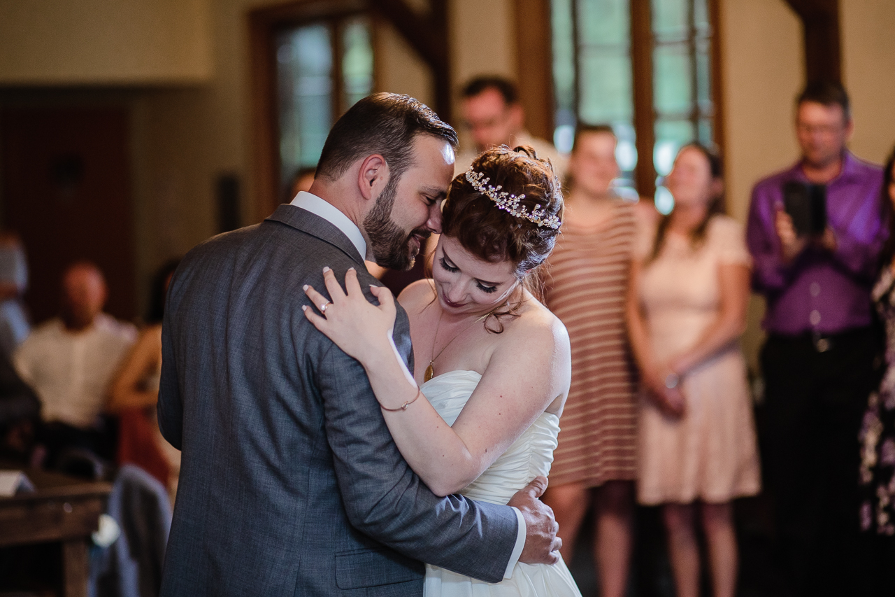 bride and groom first dance romantic during rustic themed wedding reception at Kwomais Hall by Kwomais Point Park in Ocean Park Surrey british columbia by best wedding photographer from Langley Mimsical Photography Christina Voorhorst style is documentary candid and fun photos